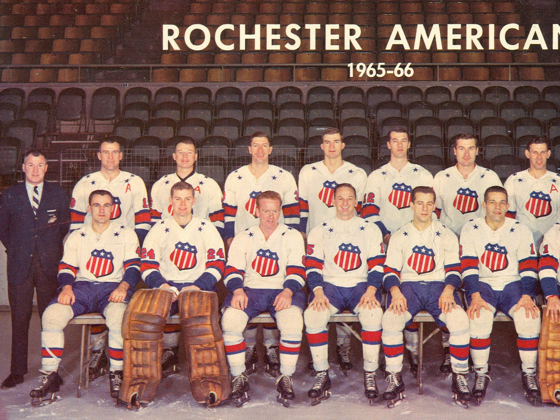"""The 1965-66 Rochester Americans were coached by Joe Crozier, back left, and won the Calder Cup championship. The team, front, from left: Darryl Sly, Gary Smith, Norm """"Red"""" Armstrong, Jim Lappin, Larry Jeffrey, Stan Smrke, Bobby Perreault, Mike Walton, Ken Carson (trainer). Second row: Joe Crozier (coach and GM), Gerry Ehman (assistant captain), Don Cherry (assistant captain), Al Arbour, Brian Conacher, Ed Litzenberger, Duane Rupp, Dick Gamble (assistant captain), Bronco Horvath, Dave Faunce (publicity director)."""