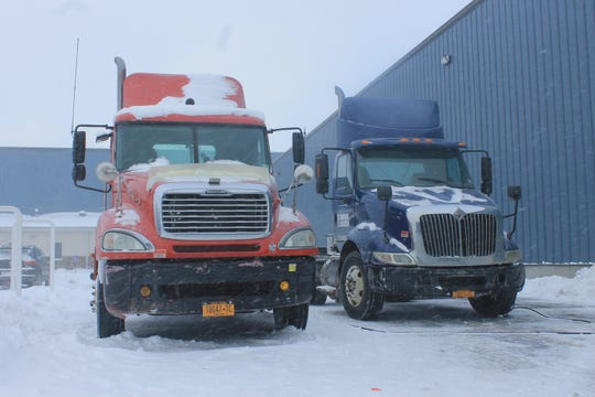 Trucks sit idle Thursday without trailers at the Conger Plastics factory in Niagara Falls.