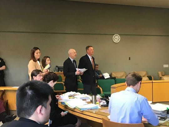 Defendants Kelsie Hoser, second from left, and Jonathan McConkey, standing far right, appear in court Thursday with their attorneys.
