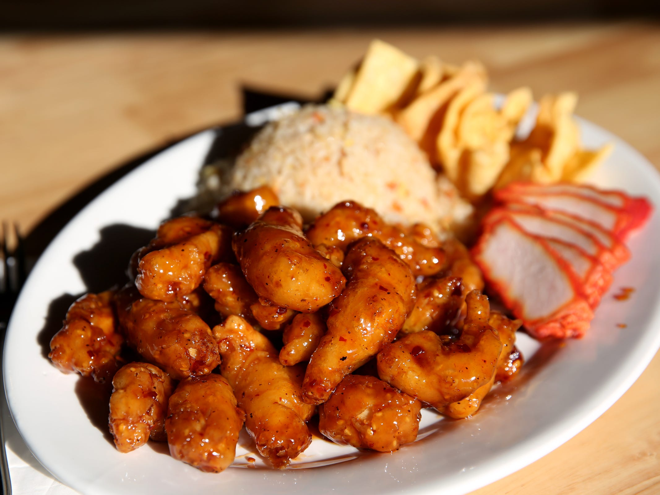 The dinner combination plate with General Tso's chicken, pork fried rice, barbecue pork and crab puffs at Chen's Family Dish in Salem on Thursday, Jan. 31, 2019.