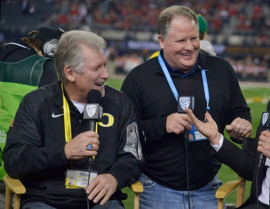 Mike Bellotti (left) refocused the Ducks' recruiting efforts in his final years to recruit nationally, and Chip Kelly helped take that to another level.