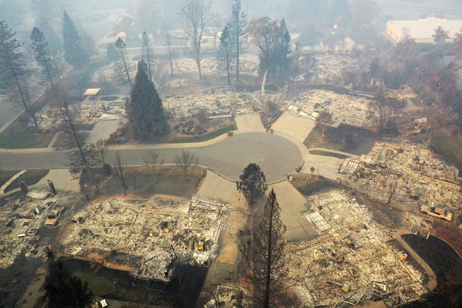 An aerial view of a neighborhood destroyed by the Camp Fire on November 15, 2018 in Paradise, California. Fueled by high winds and low humidity the Camp Fire ripped through the town of Paradise charring over 140,000 acres, killing at least 56 people and destroying more than 8,500 homes and businesses.