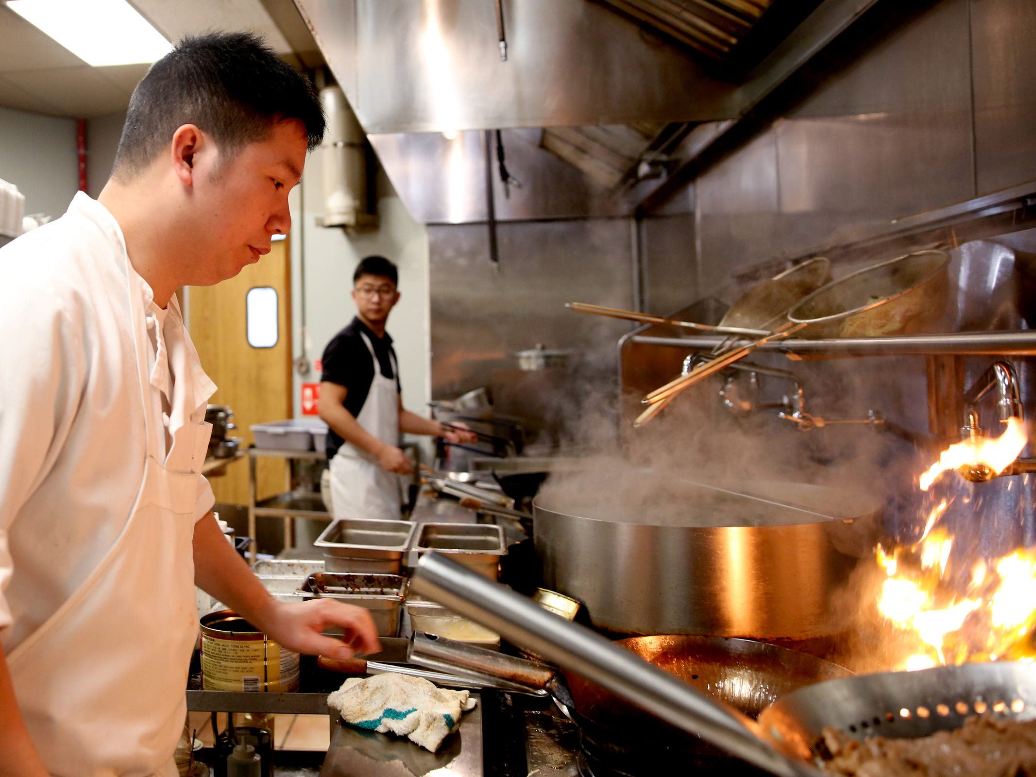 Owner Michael Chen prepares meals at Chen's Family Dish in Salem on Thursday, Jan. 31, 2019.