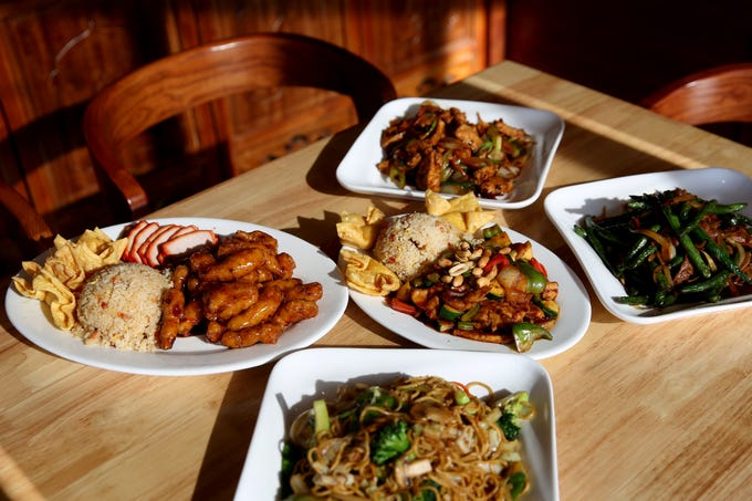 A variety of dishes, including the dinner combination plate with General Tso's chicken, pork fried rice, barbecue pork and crab puffs, the vegetable lo mein, Kung Pay chicken lunch combination, Szechuan style tofu and Cantonese black bean green beans with beef at Chen's Family Dish in Salem on Thursday, Jan. 31, 2019.