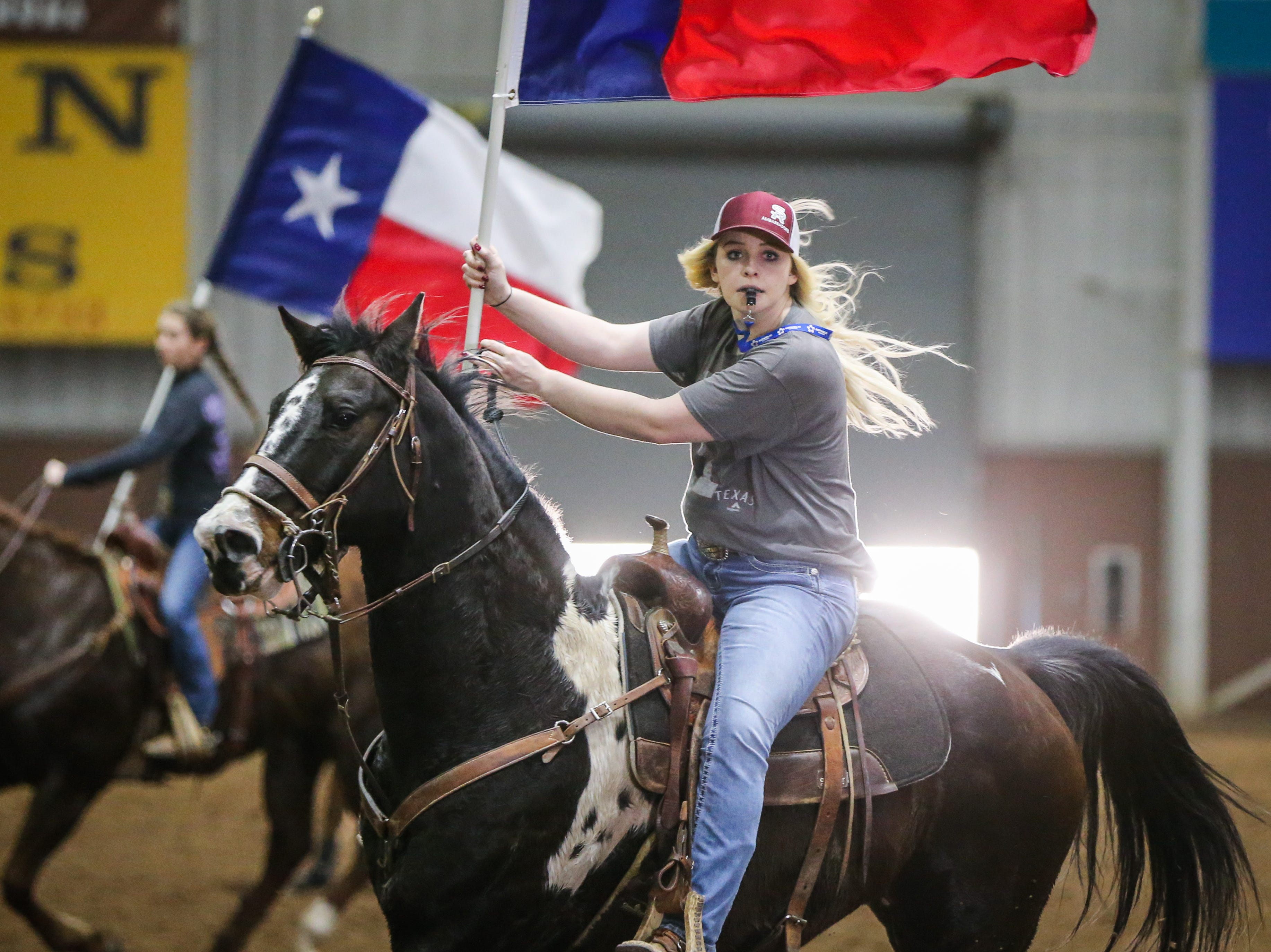 Lauren Feller leads the San Angelo Ambassadors in a drill Saturday, Jan. 26, 2019, in the Spur Arena. The team performs during the San Angelo Stock Show and Rodeo.