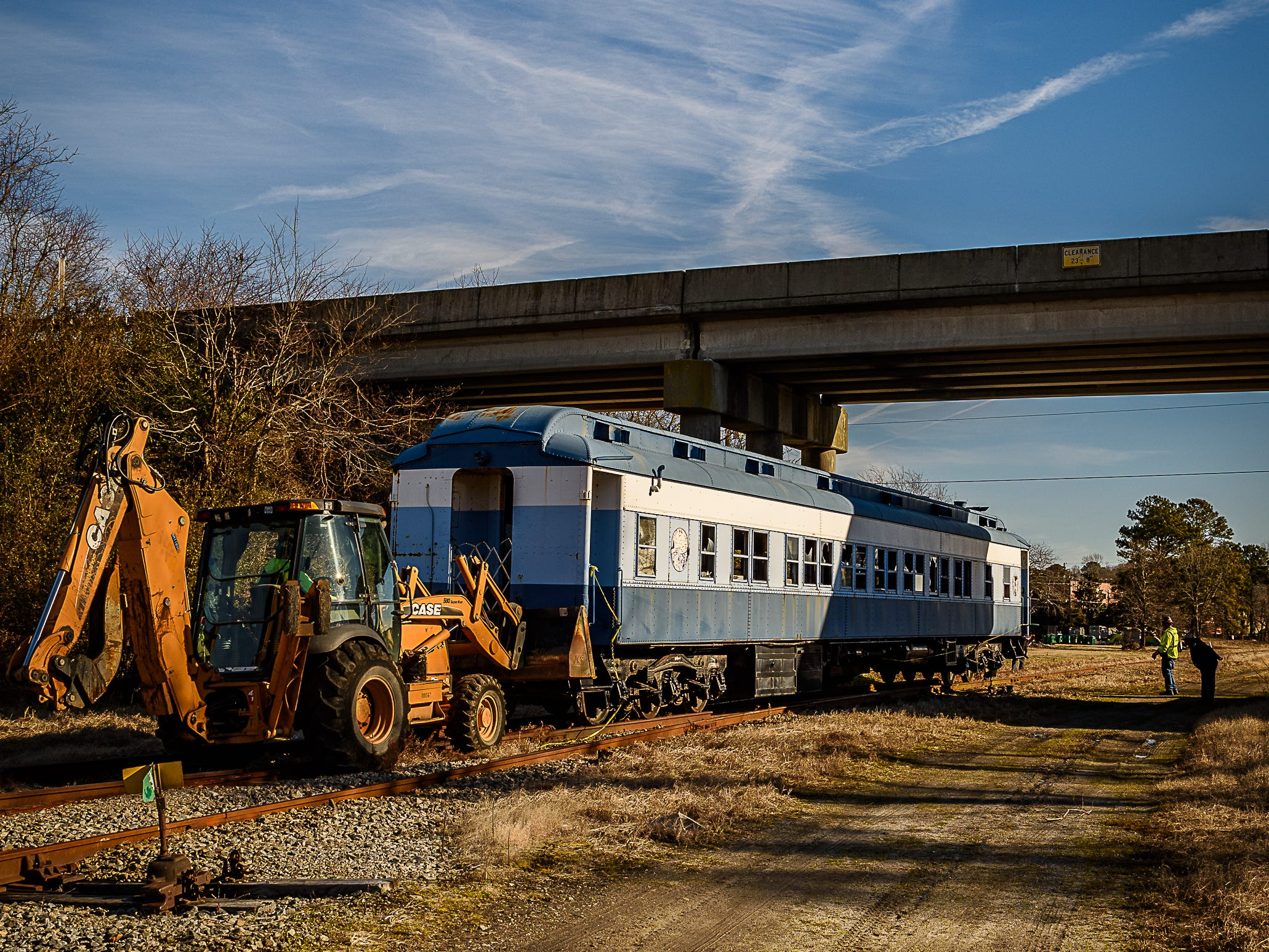 "The rail car heads under the Cape Charles ""Hump"" on its way to its new location. The car will be on display as part of the Cape Charles Historical Society's efforts to preserve the area's railroad history."