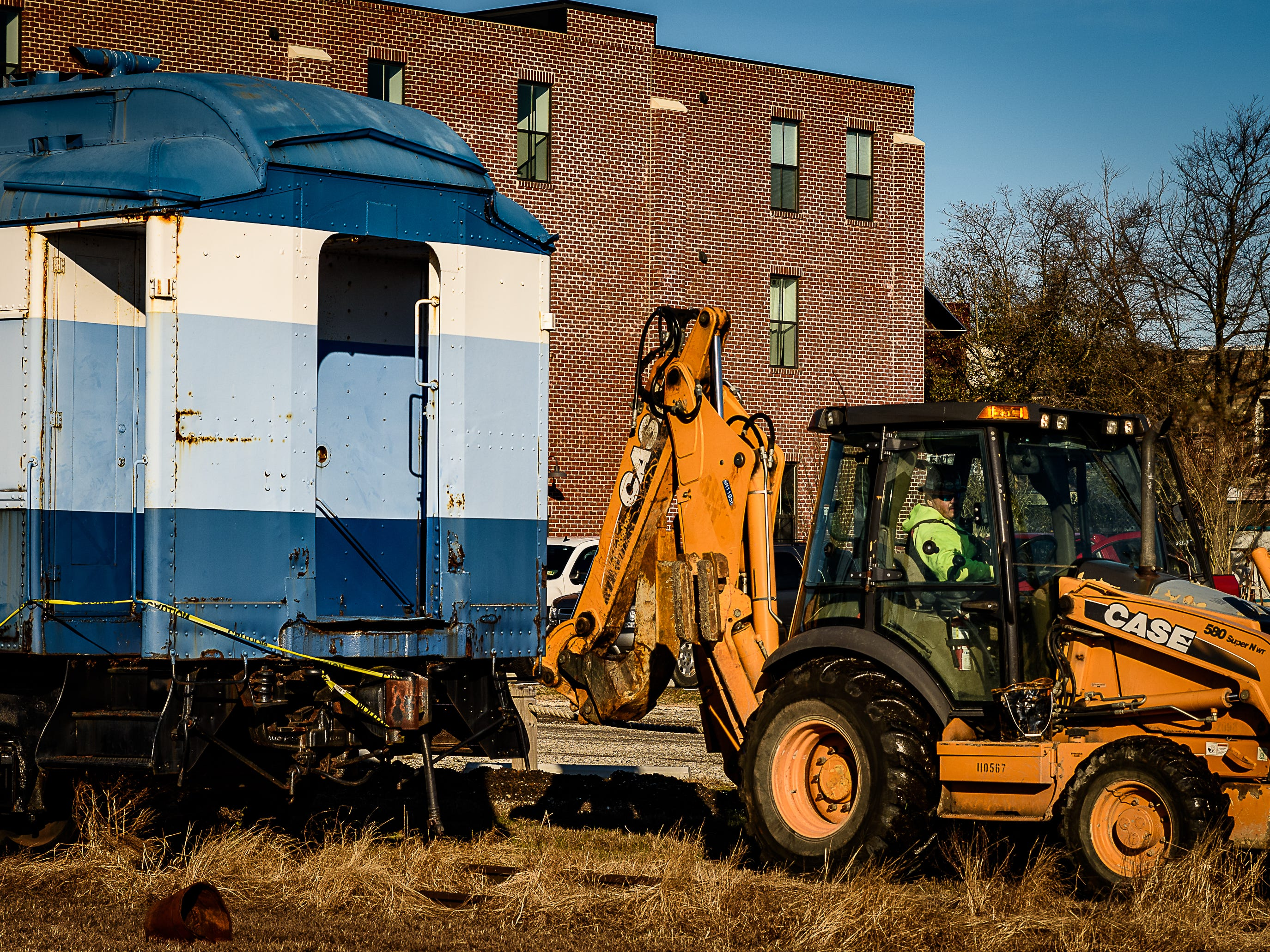 Equipment is being hooked up to begin the process of moving a railway car in Cape Charles.