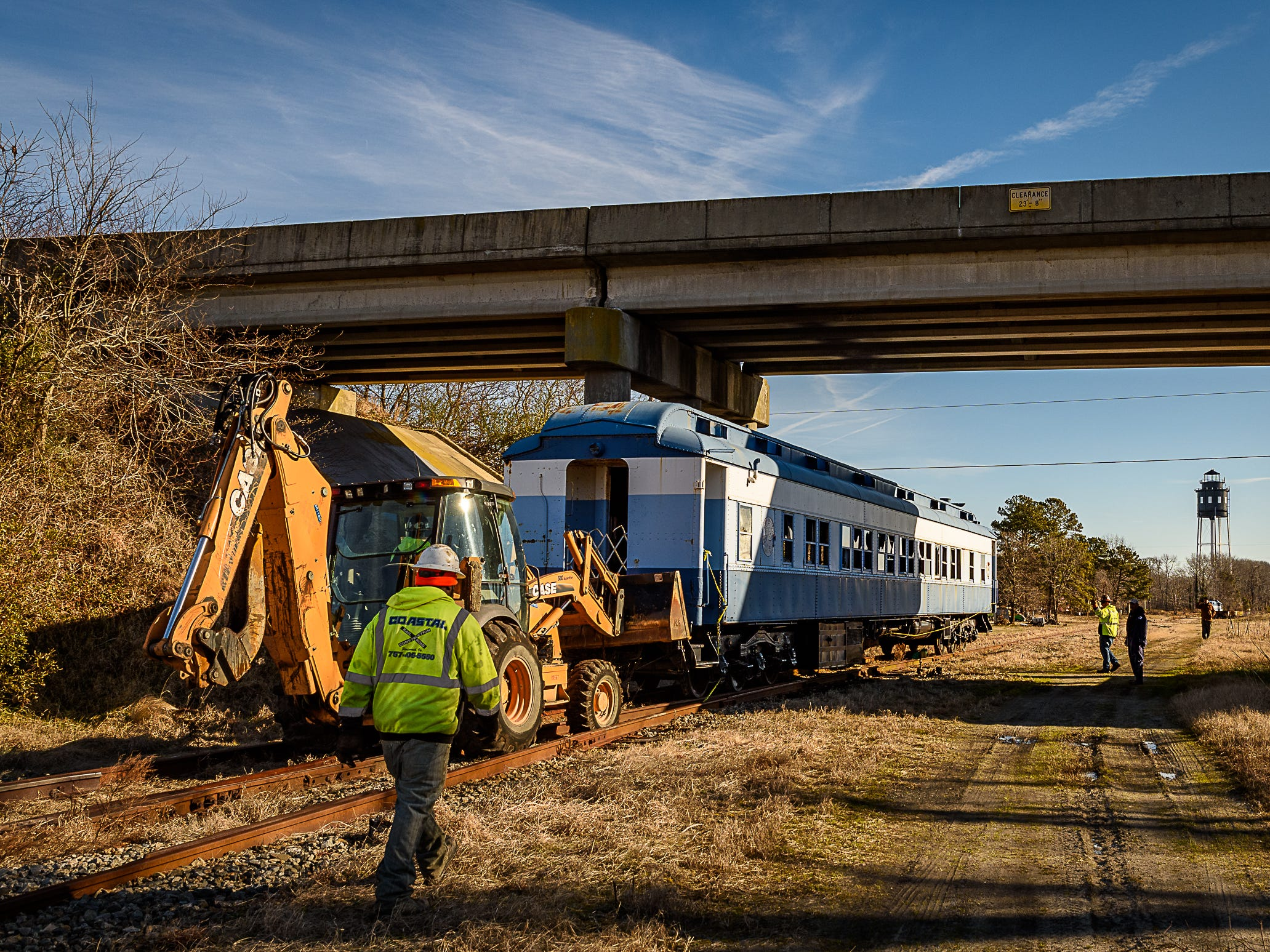 "The railcar nears its turnaround point as it crosses under the ""Hump"" or the railroad overpass near Cape Charles."