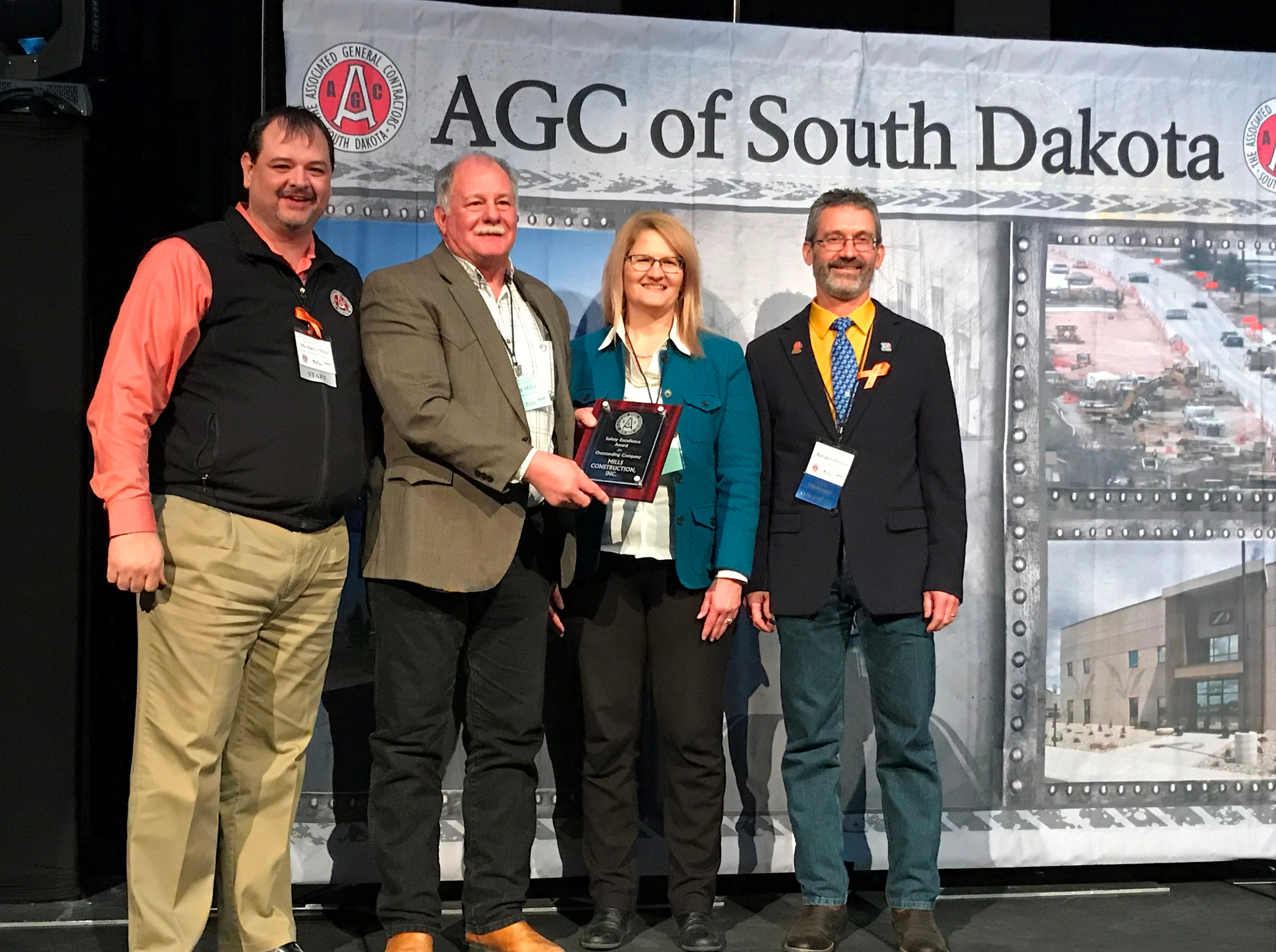 AGC of South Dakota recognized Mills Construction Inc. of Brookings with the Safety Excellence Award and the Build South Dakota Award. Pictured, from left:  Michael O'Neal, AGC of South Dakota; from Mills Construction Inc., Greg Miller, safety director, Marlene Schram and Randy Hanson.