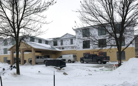 Exterior views of the Inn Hotel Okoboji, now under construction in Arnolds Park, Iowa. The 38-room hotel aims to honor the demolished Inn resort and recapture 'Classic Okoboji' with its Art Deco design.