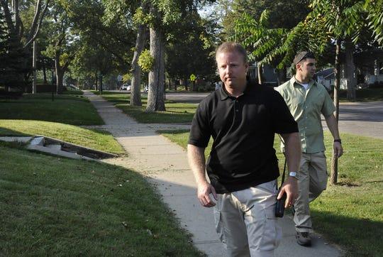 File: Sgt. Jason Gearman and Deputy Joe Bosman head to their vehicle after serving a warrant.