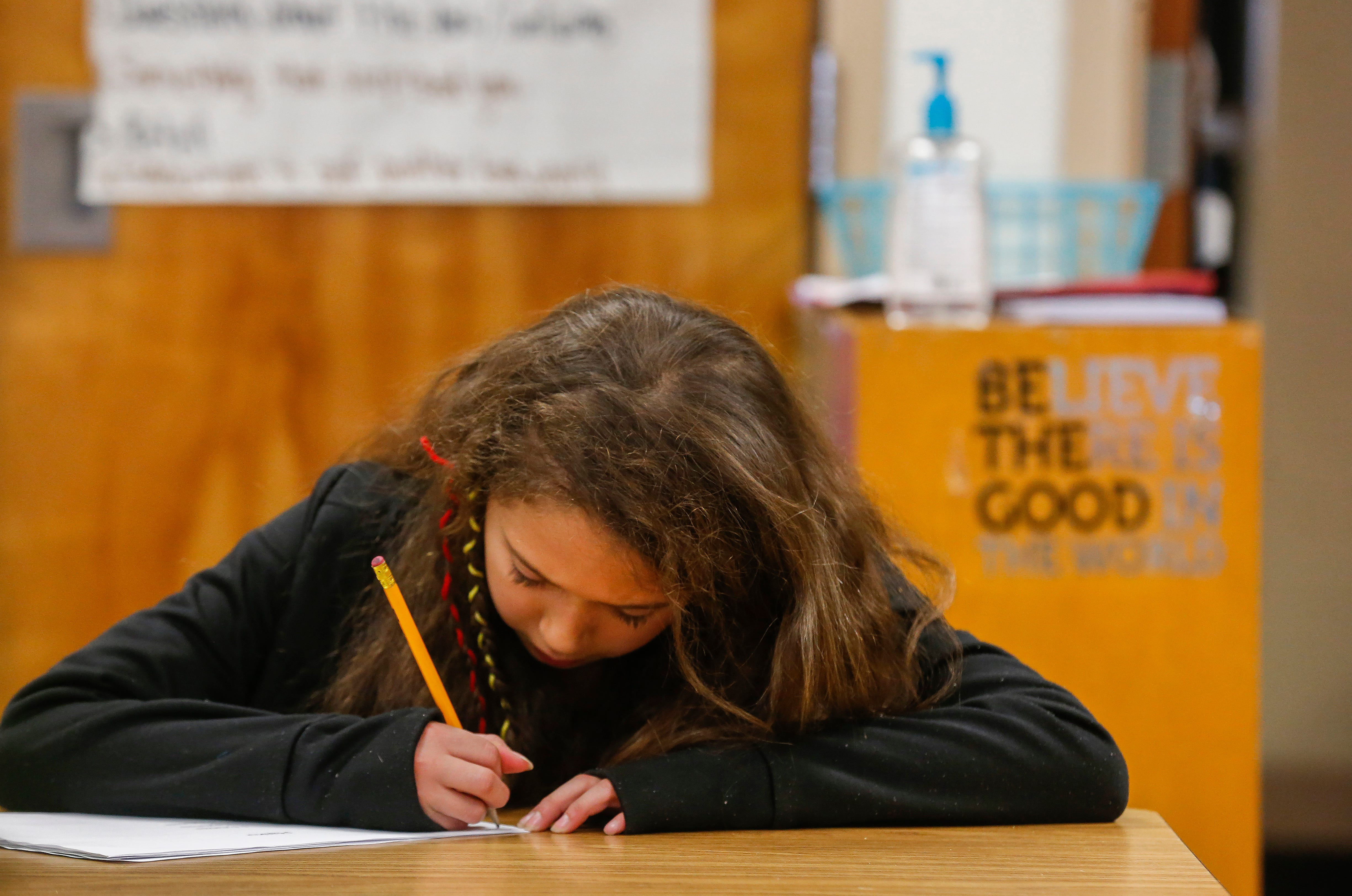 Taliste Robles-Norfolk, a third grade student at Weller Elementary School, works on a haiku during class on Thursday, Jan. 31, 2019.