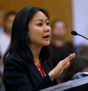 In this Monday, Jan. 28, 2019 photo, Del. Kathy Tran, D-Fairfax, presents HB2491, her bill dealing with eliminating some requirements for abortion, to a subcommittee of the House Courts of Justice committee inside the State Capitol in Richmond, Va. The bill was killed after an intense questioning of Tran by House Majority Leader C. Todd Gilbert, R-Shenandoah, the subcommittee chairman.
