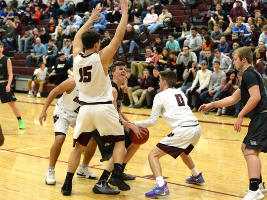 Stuarts Draft's defense collapses on the Wilson offense Wednesday night in a Shenandoah District boys basketball game.