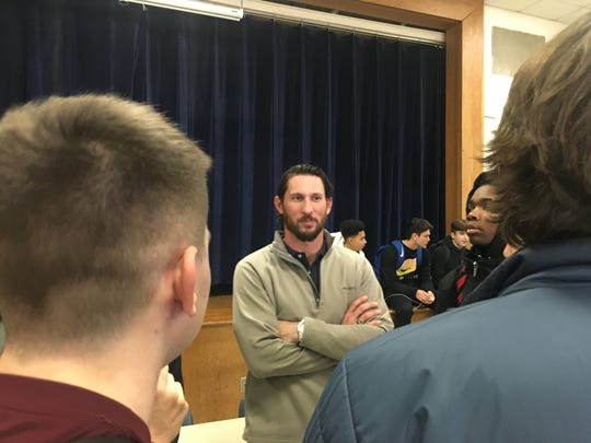 Jacob Phillips, the new head football coach for Staunton High School, talks to his players Thursday afternoon following a press conference at the school.
