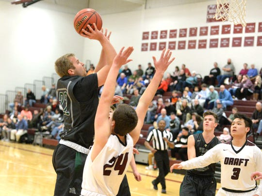 Wilson Memorial's Matt Poole puts up a shot against Stuarts Draft Wednesday night in a Shenandoah District boys basketball game.