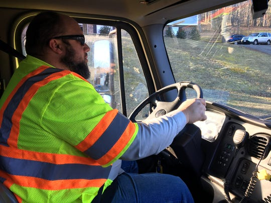 Christopher Lambert wakes up at 3 a.m. to get to work and handle administrative duties before starting the trash pickup route at 6:30 a.m.