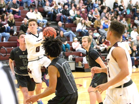 Looking for a shot, Stuarts Draft's Jared Rosen drives between Wilson defenders Wednesday night in a Shenandoah District boys basketball game.