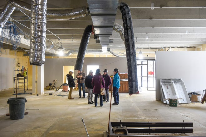People stand in the main space of the new St. Cloud Times offices under construction Thursday, Jan. 31, at 24 Eighth Ave. S, St. Cloud.