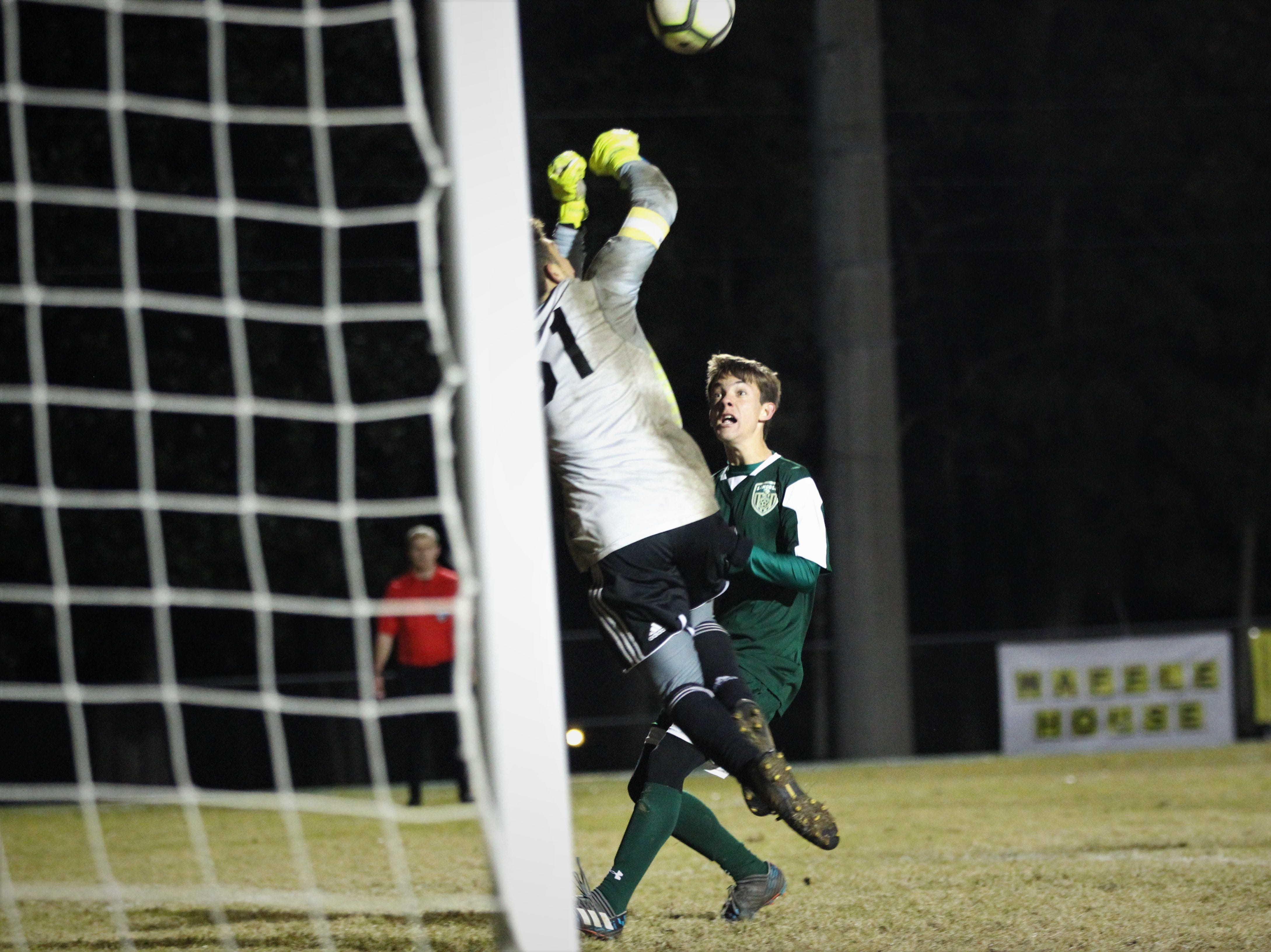 Chiles keeper Abraheim Darwish goes for a save in the final minutes as Chiles' boys soccer team beat Lincoln 1-0 in a District 2-4A semifinal on Jan. 30, 2019.