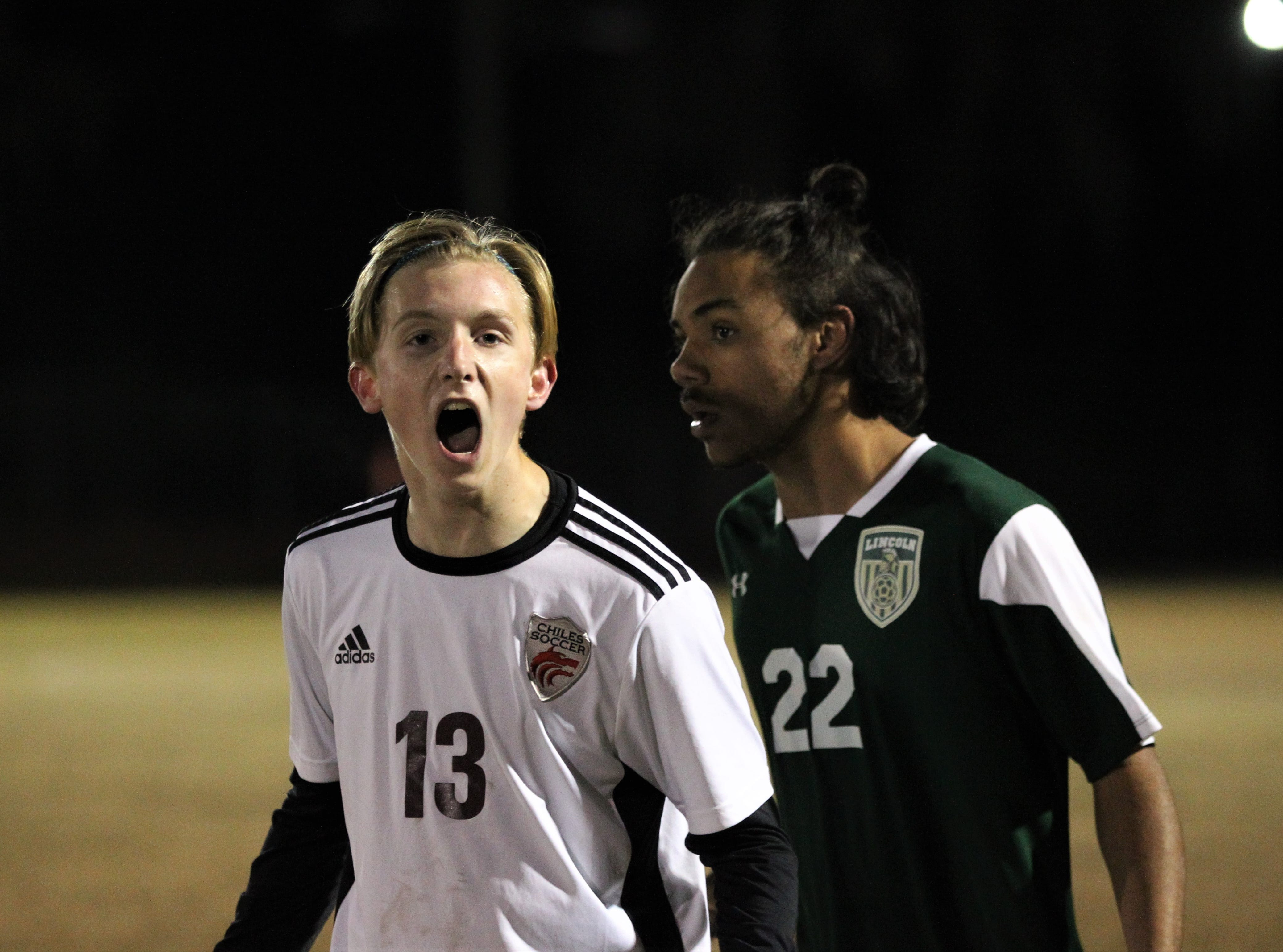 Chiles' Owen Hawkins yells to the Timberwolves' fans as Chiles' boys soccer team beat Lincoln 1-0 in a District 2-4A semifinal on Jan. 30, 2019.