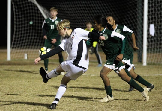 Chiles' Owen Hawkins takes a shot on goal that curves just outside the post as Chiles' boys soccer team beat Lincoln 1-0 in a District 2-4A semifinal on Jan. 30, 2019.