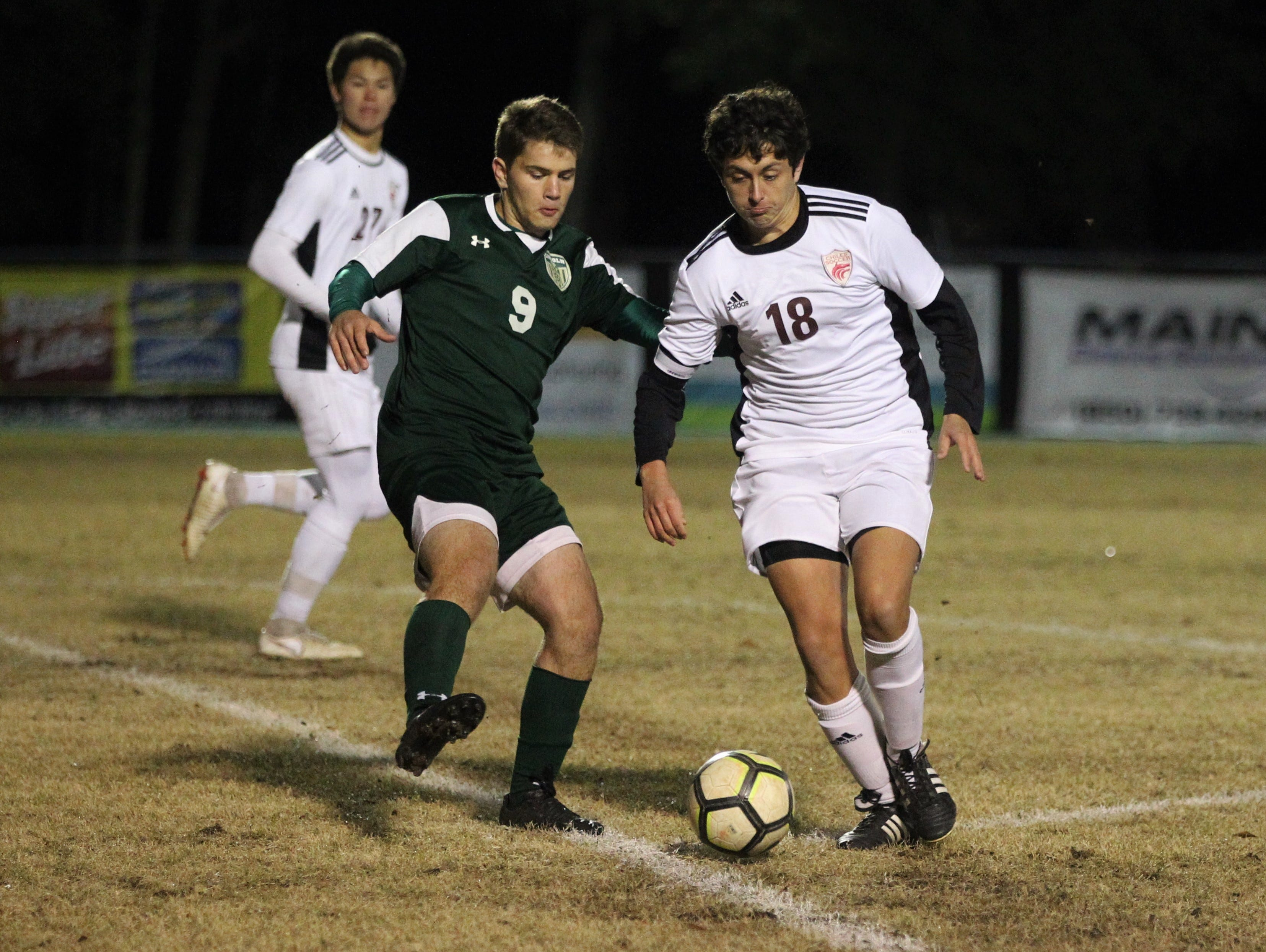 Chiles midfielder Patrick O'Sullivan tries to get past Lincoln's Sean Yearwood as Chiles' boys soccer team beat Lincoln 1-0 in a District 2-4A semifinal on Jan. 30, 2019.
