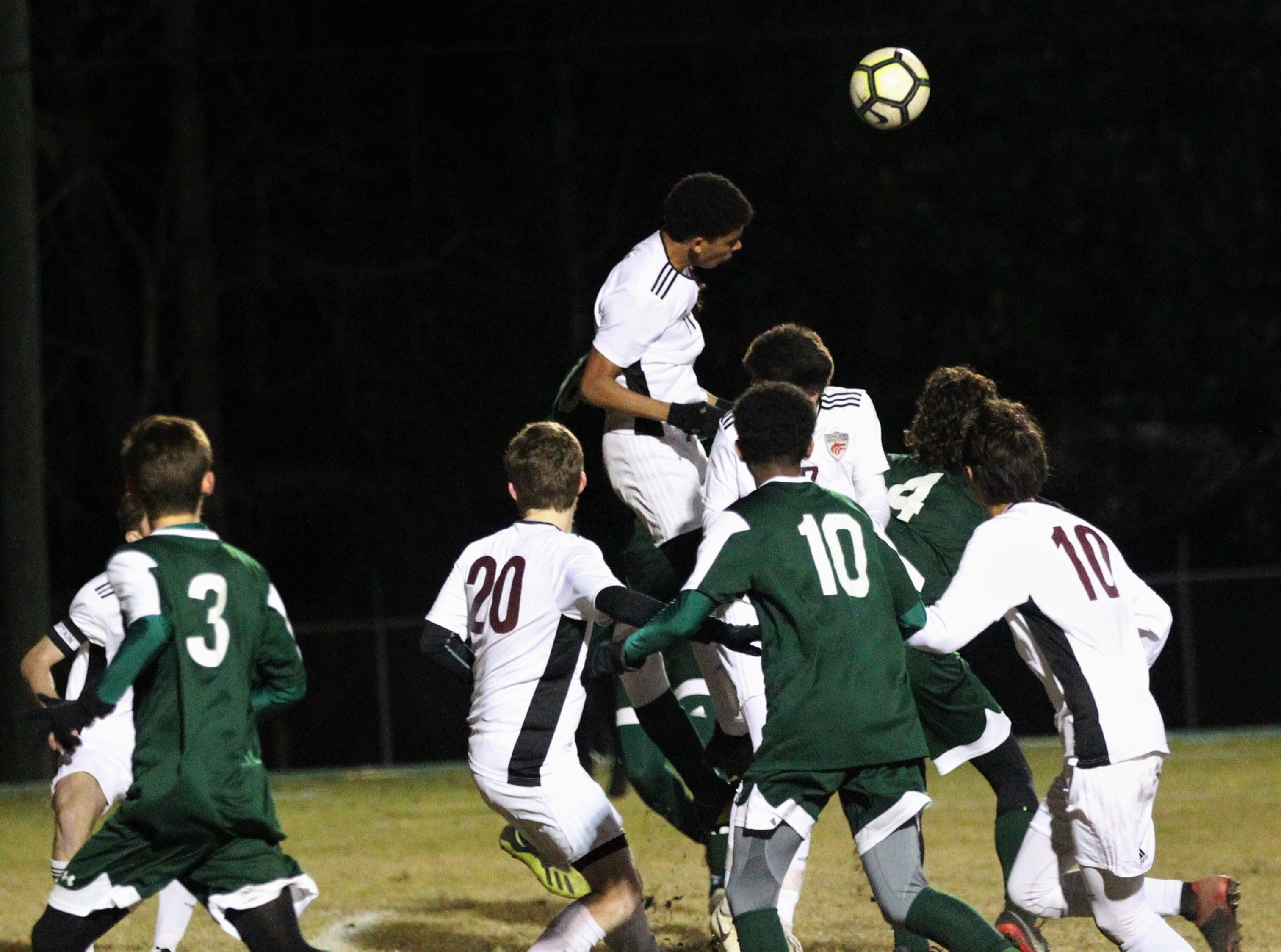 Chiles' Will Johnson makes a header as Chiles' boys soccer team beat Lincoln 1-0 in a District 2-4A semifinal on Jan. 30, 2019.