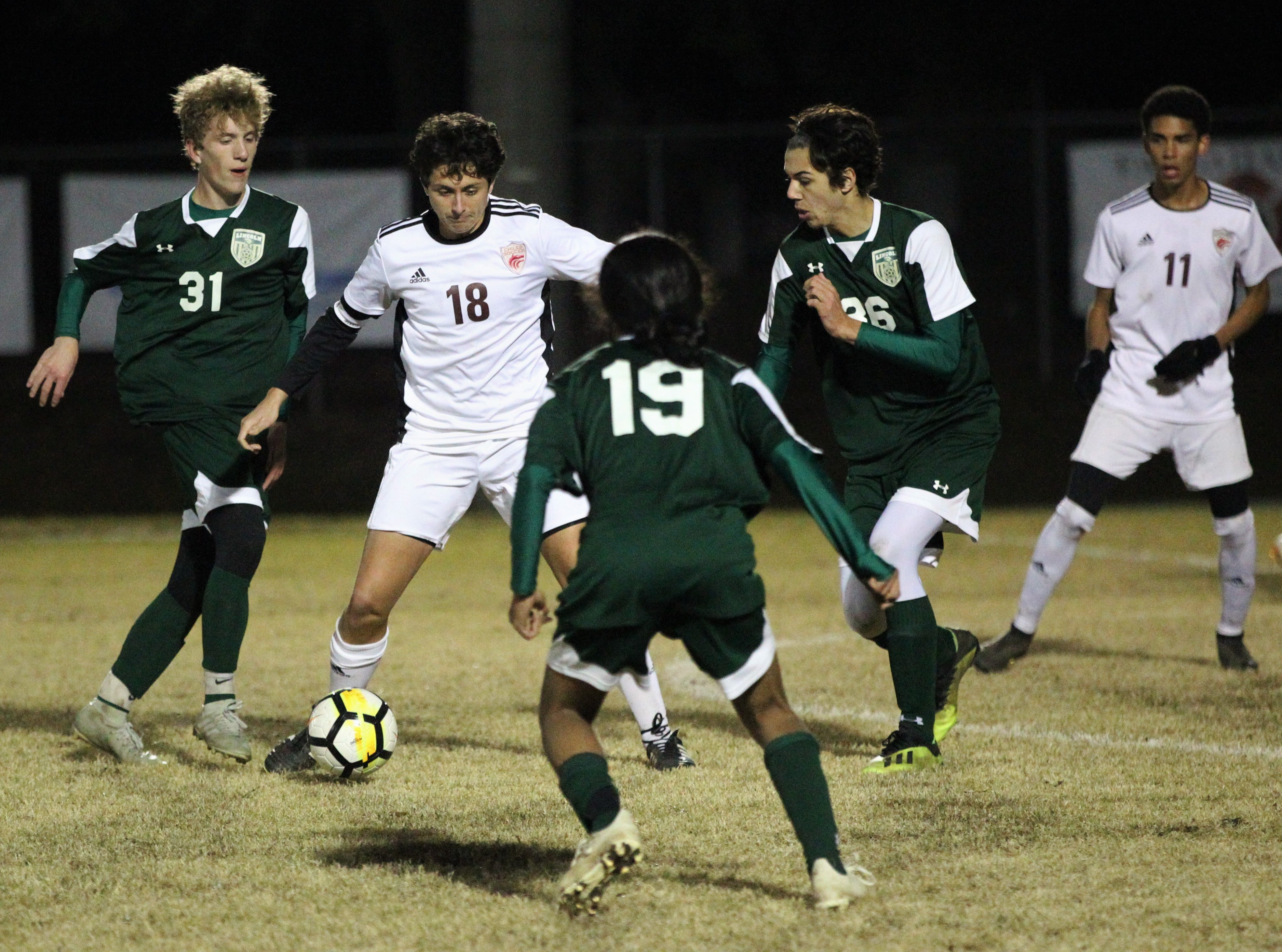 Chiles midfielder Patrick O'Sullivan tries to get through three Lincoln players as Chiles' boys soccer team beat Lincoln 1-0 in a District 2-4A semifinal on Jan. 30, 2019.