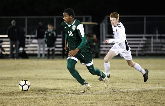 Lincoln's David Monroe races upfield as Lincoln's Kyle Otis gives chase as Chiles' boys soccer team beat Lincoln 1-0 in a District 2-4A semifinal on Jan. 30, 2019.