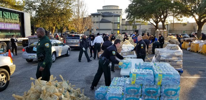 More than 500 families received food during a Farm Share distribution event at the Leon County Sheriff's Office on Thursday.