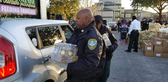 Leon County Sheriff's Office deputies helped distribute more than 30,000 pounds of food to federal workers still struggling after the U.S. government shutdown and more than 500 families.