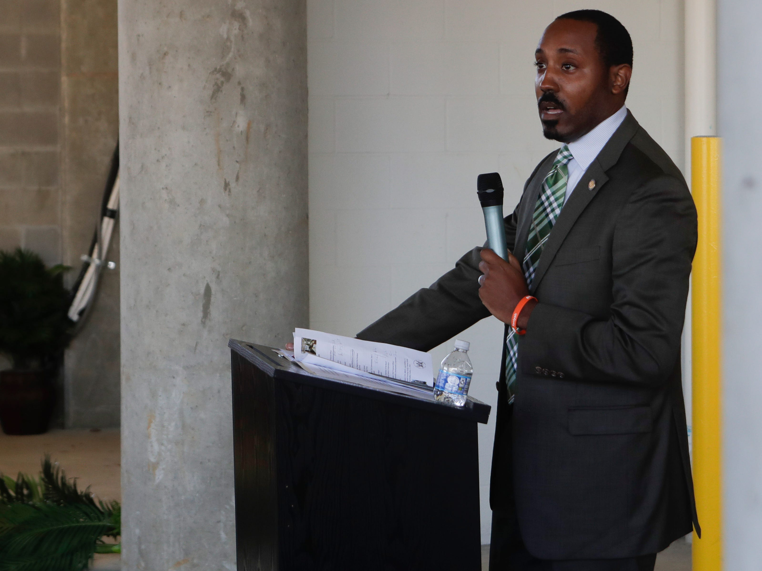 Rep. Ramon Alexander speaks during the grand opening celebration for the Casañas Village Apartments at Frenchtown Square Thursday, Jan. 31, 2019.