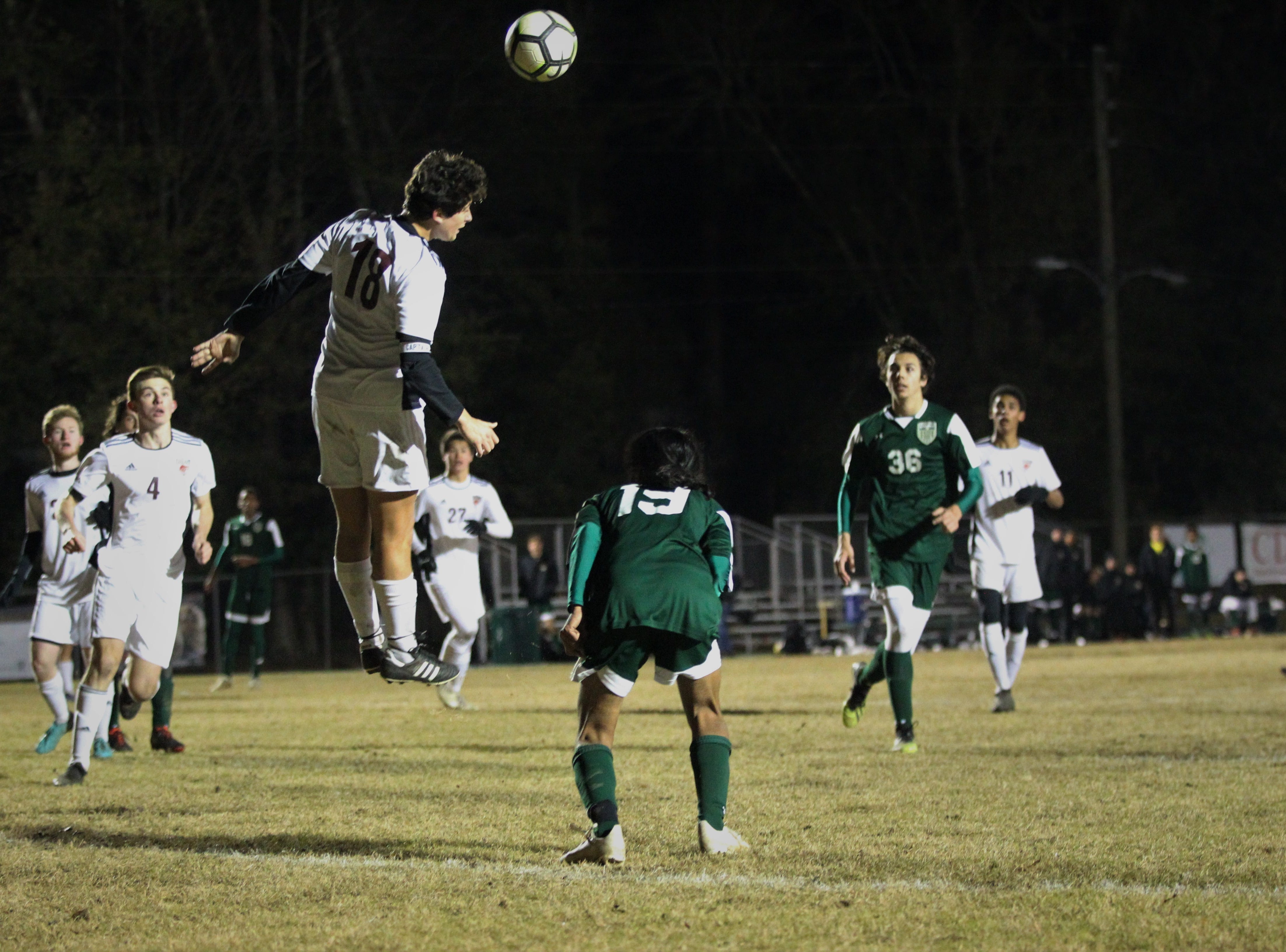 Chiles' Patrick O'Sullivan heads away a set piece as Chiles' boys soccer team beat Lincoln 1-0 in a District 2-4A semifinal on Jan. 30, 2019.