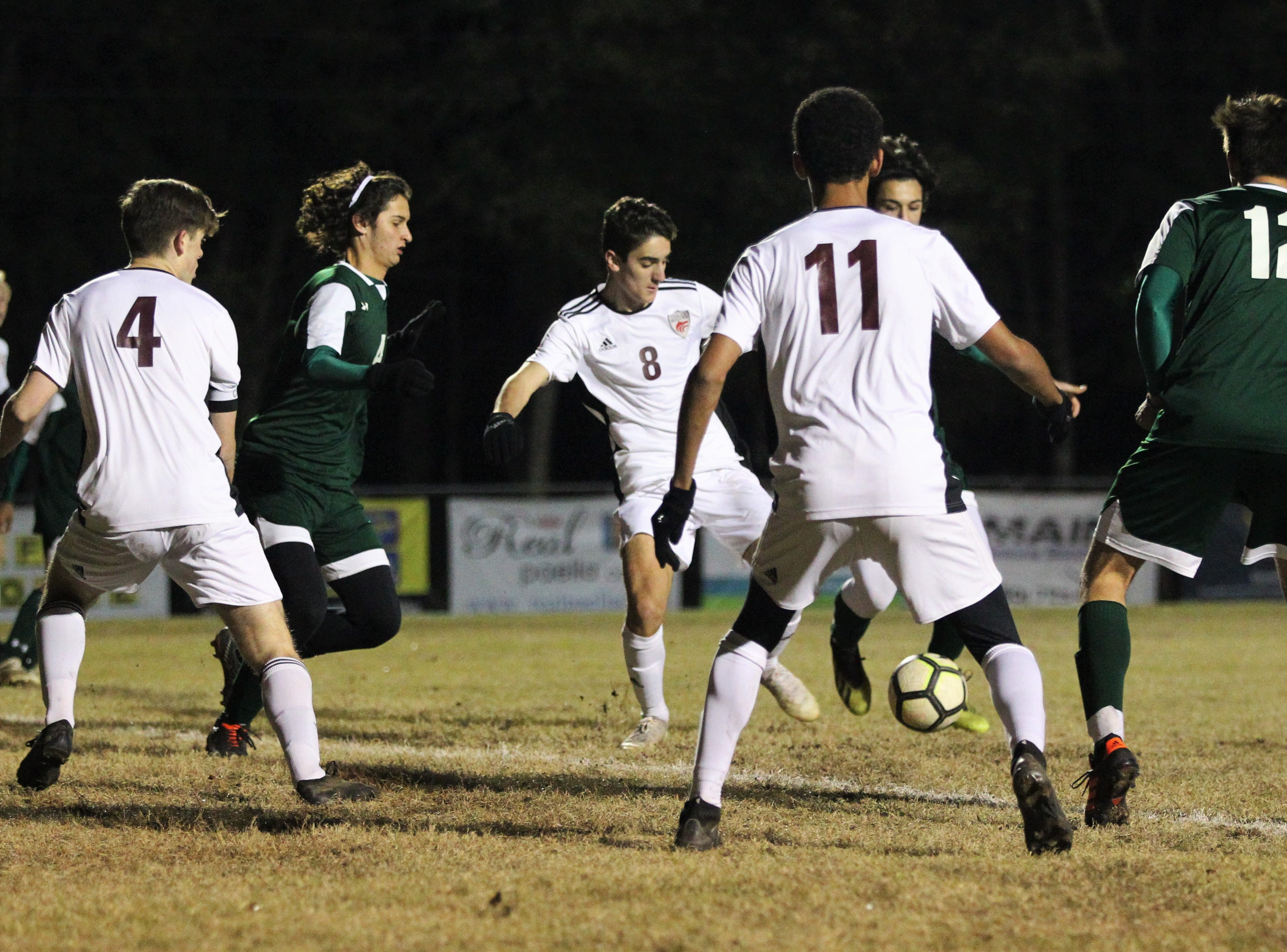 Chiles' Tag Lowery tries to gain possession and get off a shot as Chiles' boys soccer team beat Lincoln 1-0 in a District 2-4A semifinal on Jan. 30, 2019.
