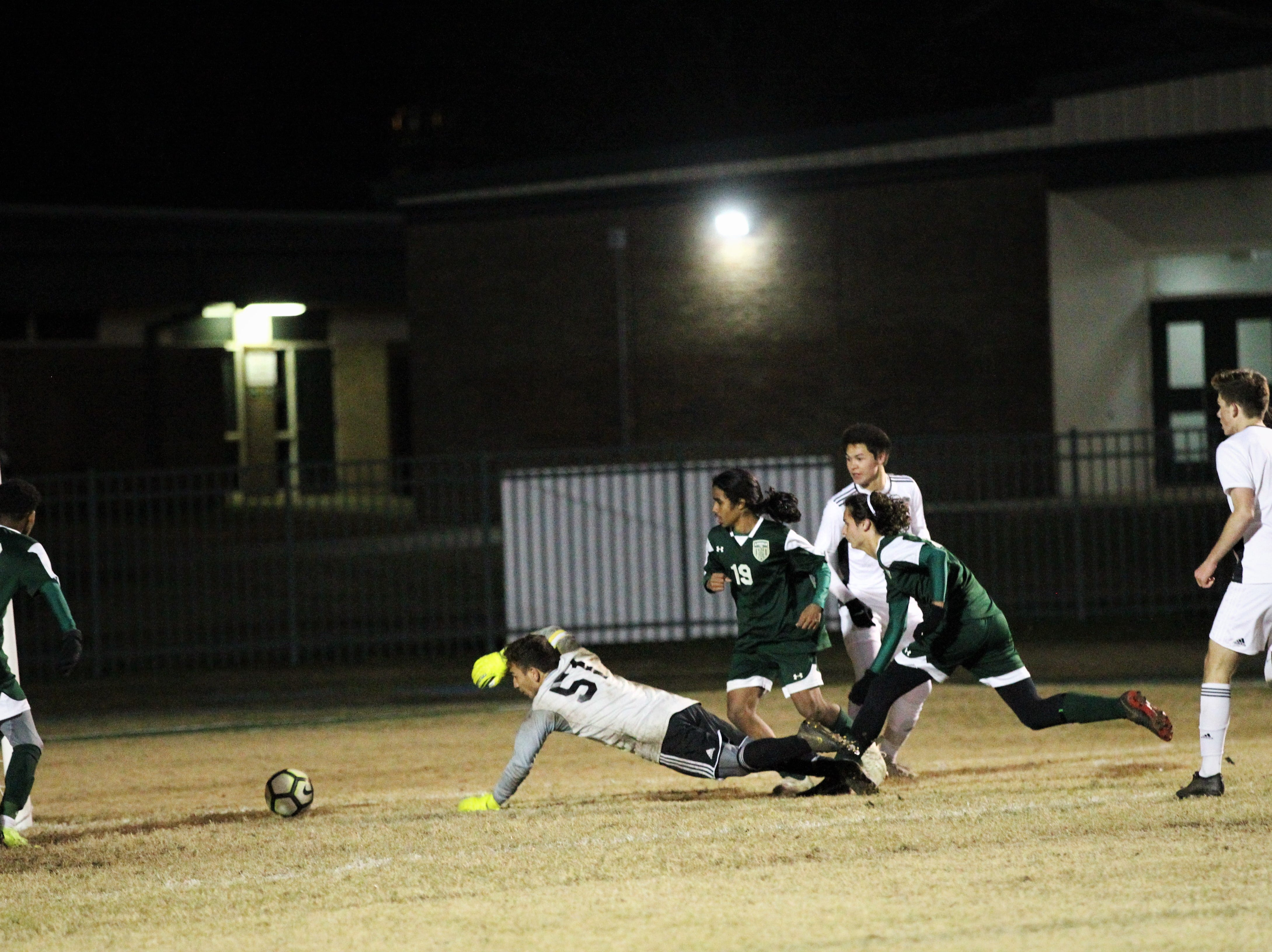 Chiles keeper Abraheim Darwish dives back towards goal as a shot squirts past, but it goes just wide of goal as Chiles' boys soccer team beat Lincoln 1-0 in a District 2-4A semifinal on Jan. 30, 2019.