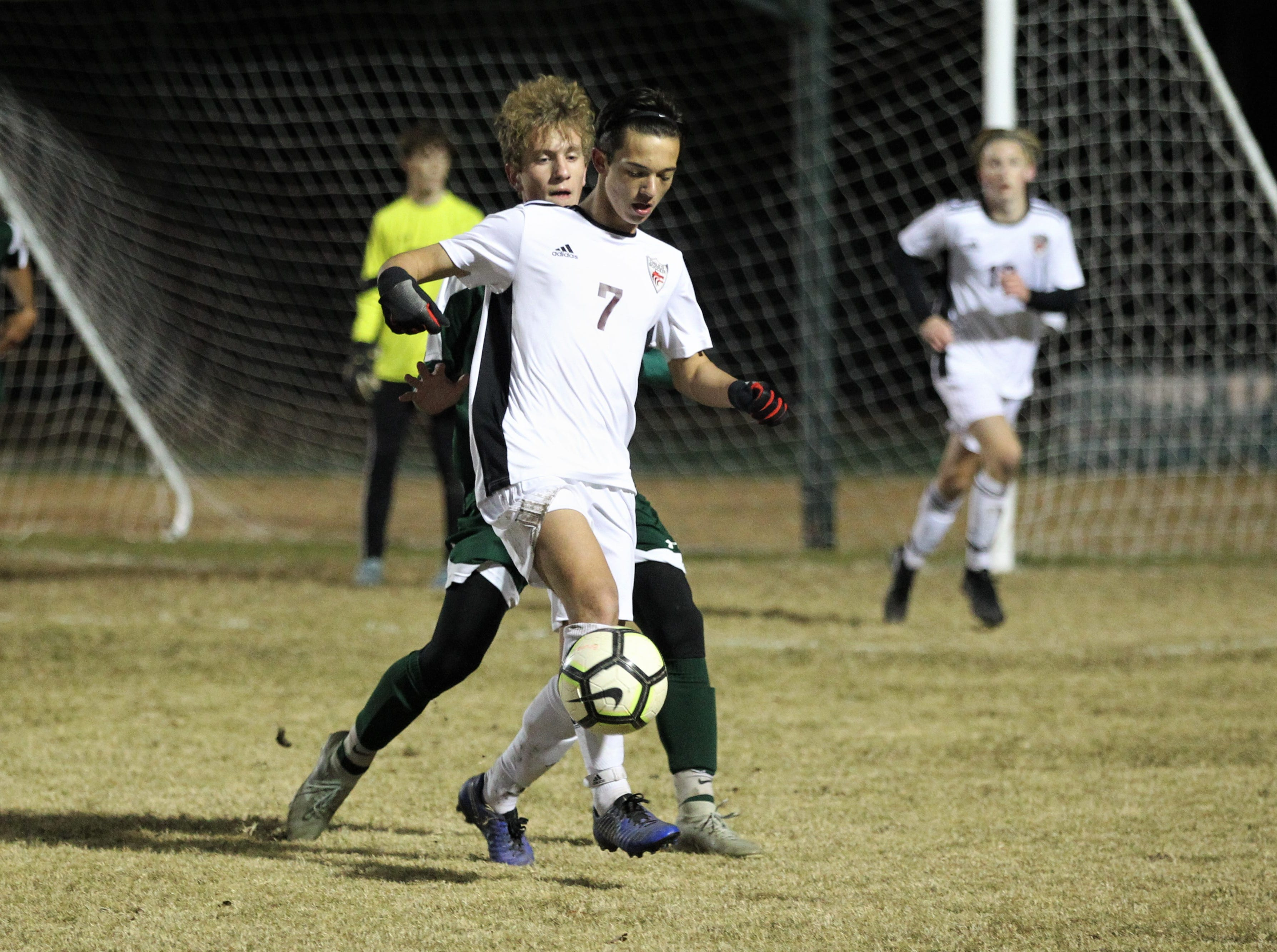 Chiles midfielder Logan Thompson dribbles with his back to goal as Chiles' boys soccer team beat Lincoln 1-0 in a District 2-4A semifinal on Jan. 30, 2019.