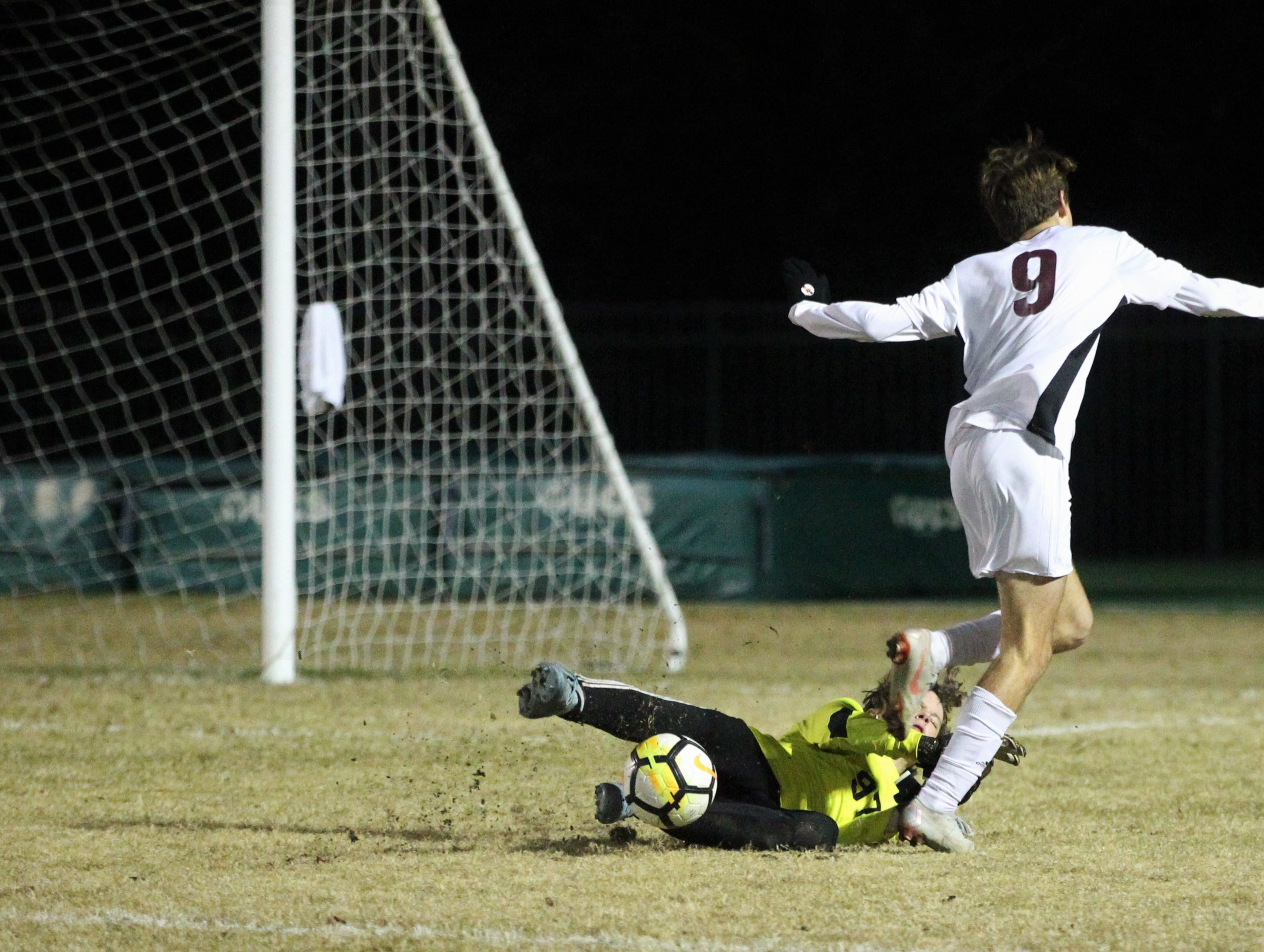 Chiles' Robbie Allman gets tripped up as Lincoln keeper Aiden Reiding reaches a through ball first as Chiles' boys soccer team beat Lincoln 1-0 in a District 2-4A semifinal on Jan. 30, 2019.