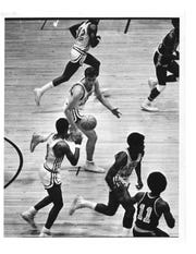 FSU's Dave Cowens, center, looks for the ball on a fastbreak.
