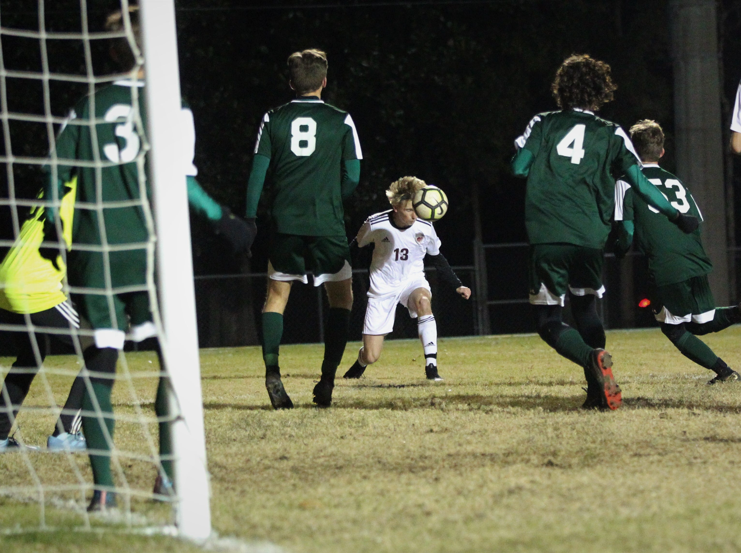 Chiles' Owen Hawkins heads a pass back into the box as Chiles' boys soccer team beat Lincoln 1-0 in a District 2-4A semifinal on Jan. 30, 2019.
