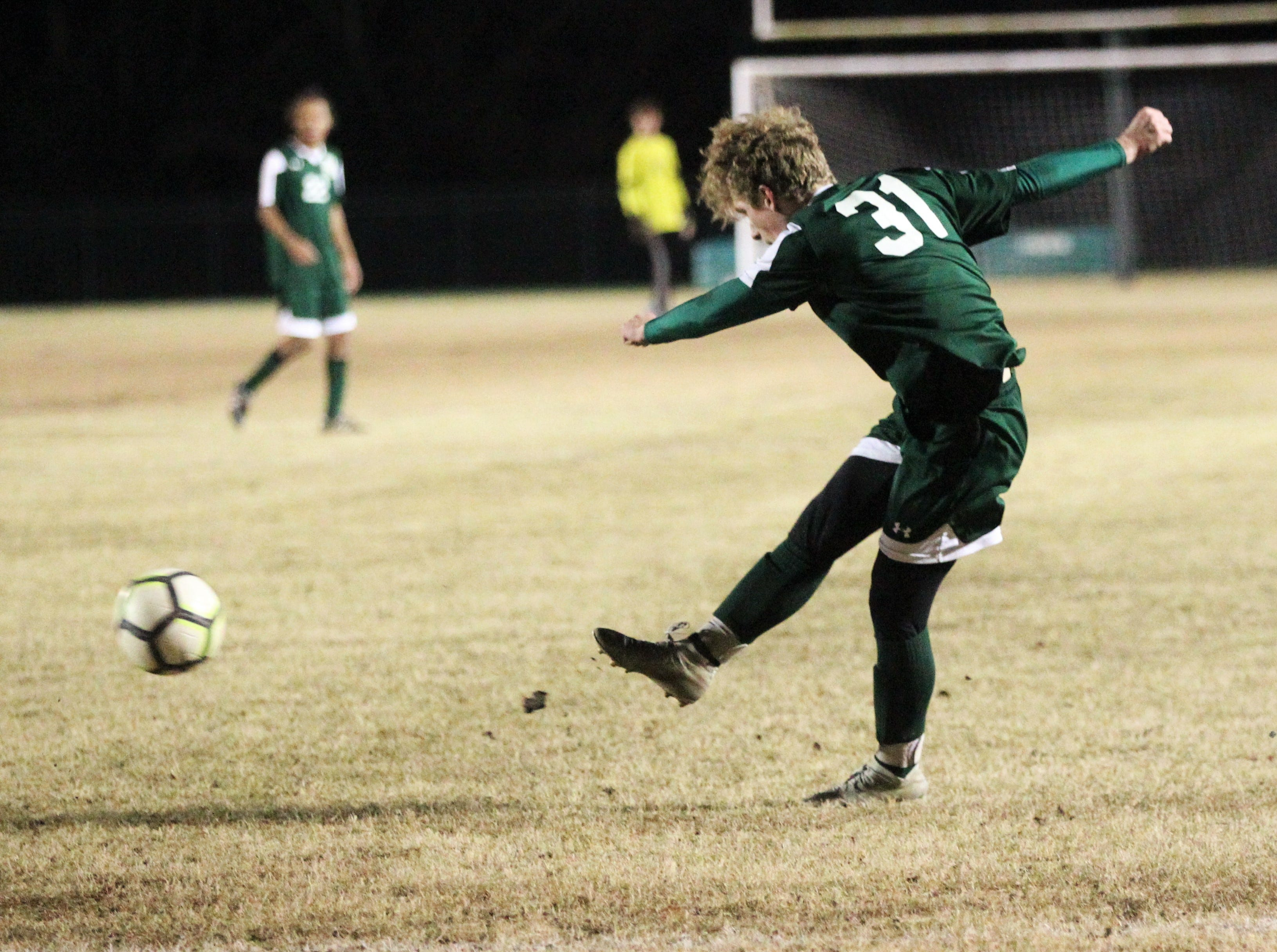 Lincoln's Kyle Spratt takes a shot on goal as Chiles' boys soccer team beat Lincoln 1-0 in a District 2-4A semifinal on Jan. 30, 2019.