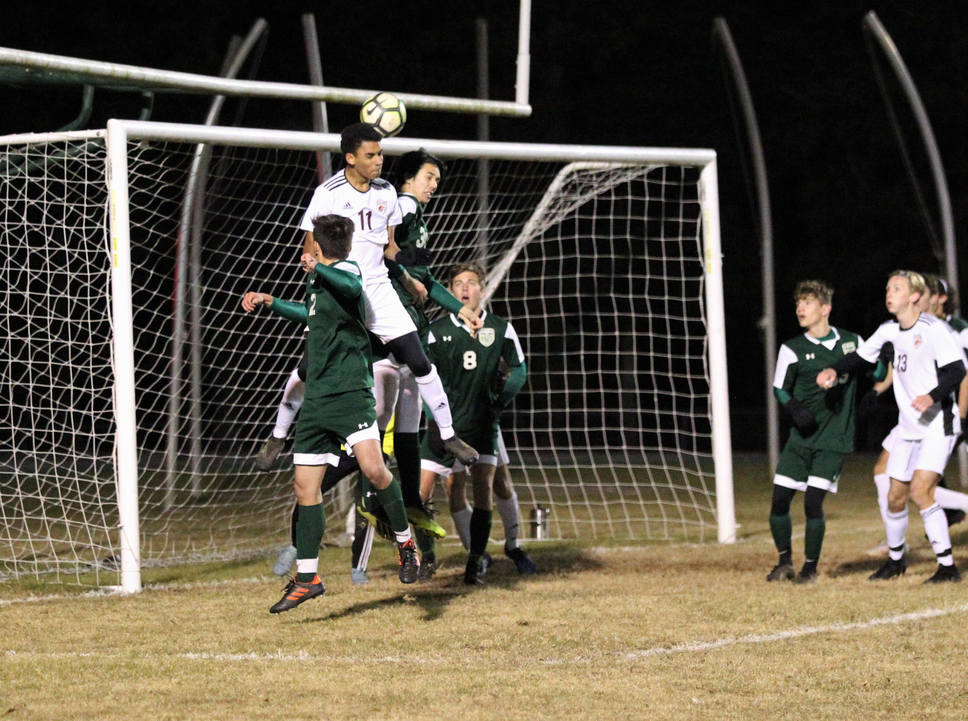 Chiles senior Will Johnson flicks a header towards back post off a throw-in as Chiles' boys soccer team beat Lincoln 1-0 in a District 2-4A semifinal on Jan. 30, 2019.
