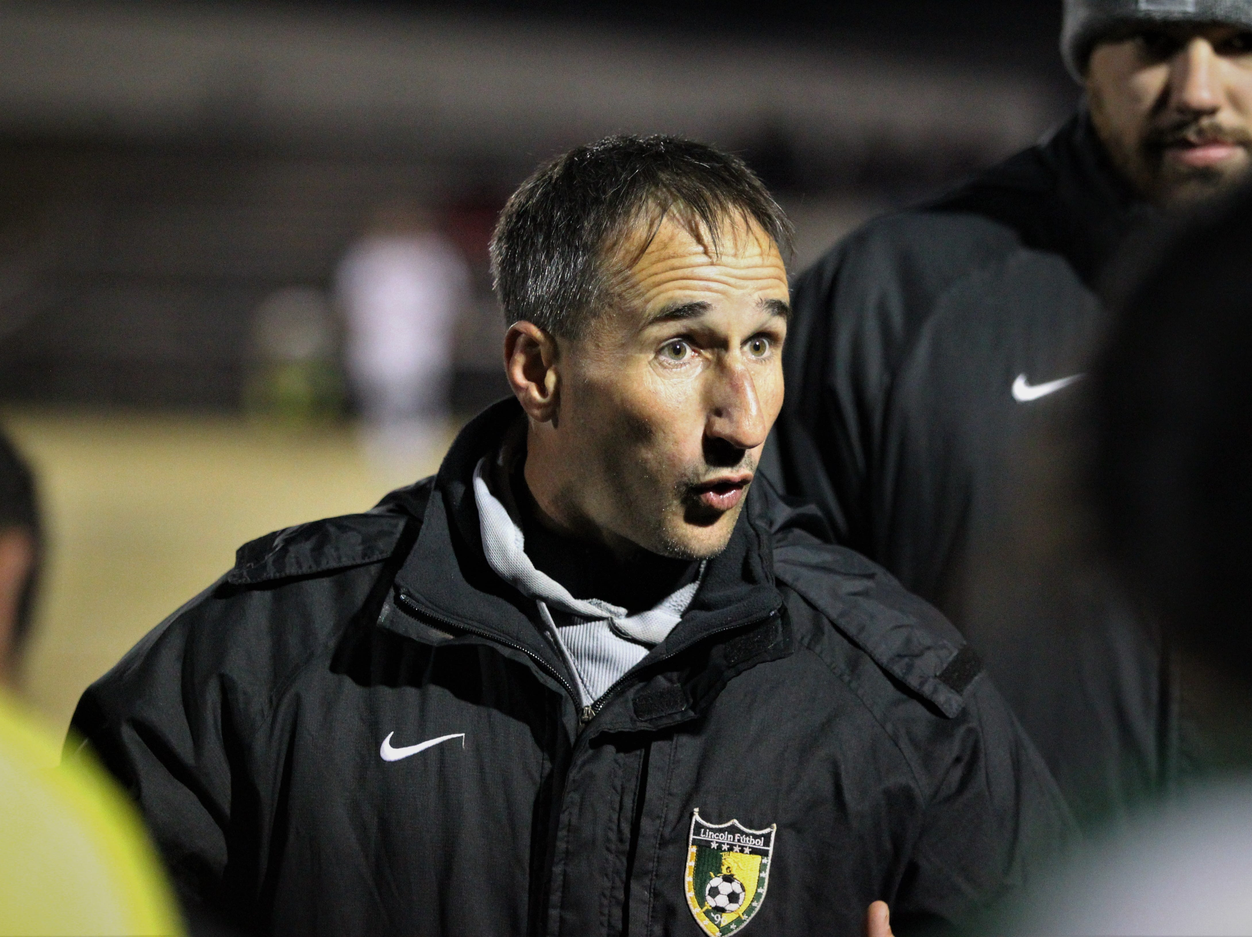 Lincoln boys soccer coach Josh Bruno talks to his team during a break in action as Chiles beat Lincoln 1-0 in a District 2-4A semifinal on Jan. 30, 2019.