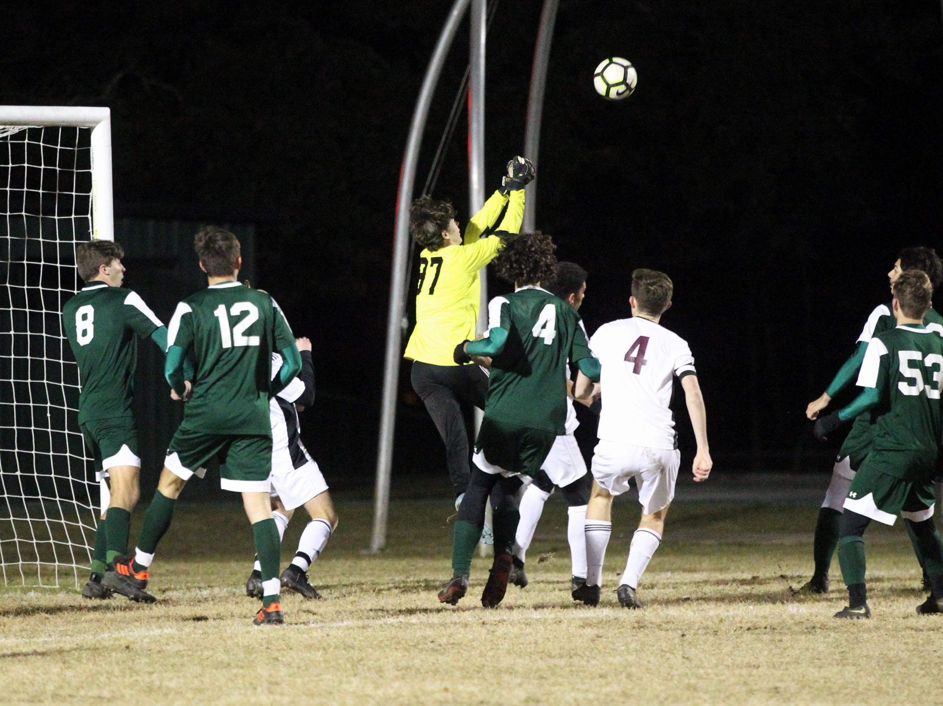 Lincoln keeper Aiden Reiding goes to make a clearance punch as Chiles' boys soccer team beat Lincoln 1-0 in a District 2-4A semifinal on Jan. 30, 2019.