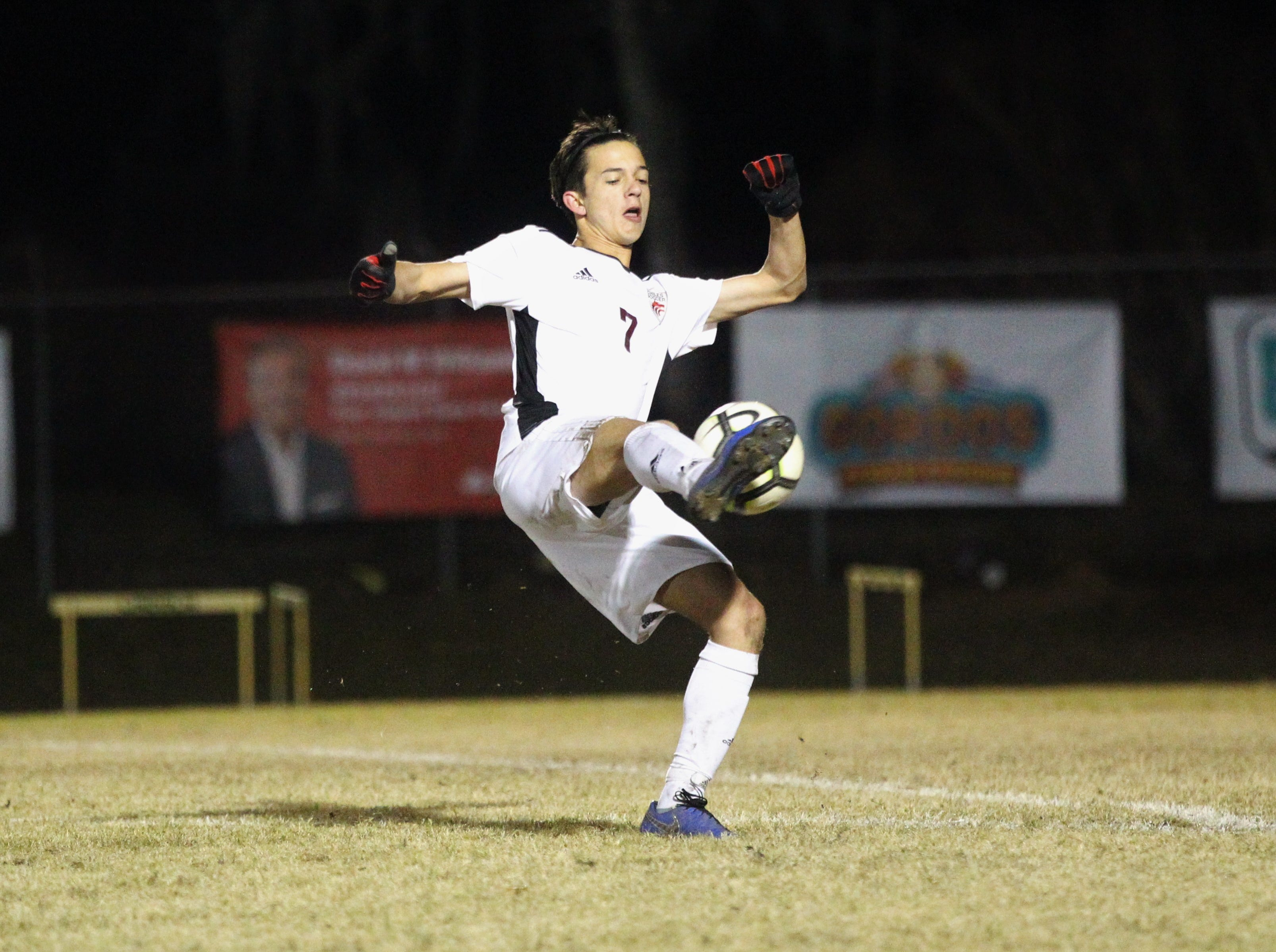 Chiles' Logan Thompson takes a shot on goal as Chiles' boys soccer team beat Lincoln 1-0 in a District 2-4A semifinal on Jan. 30, 2019.