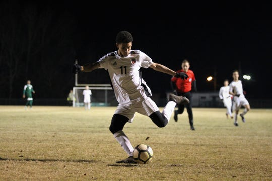Chiles senior Will Johnson rips a shot that hits the netting just outside of goal as Chiles' boys soccer team beat Lincoln 1-0 in a District 2-4A semifinal on Jan. 30, 2019.