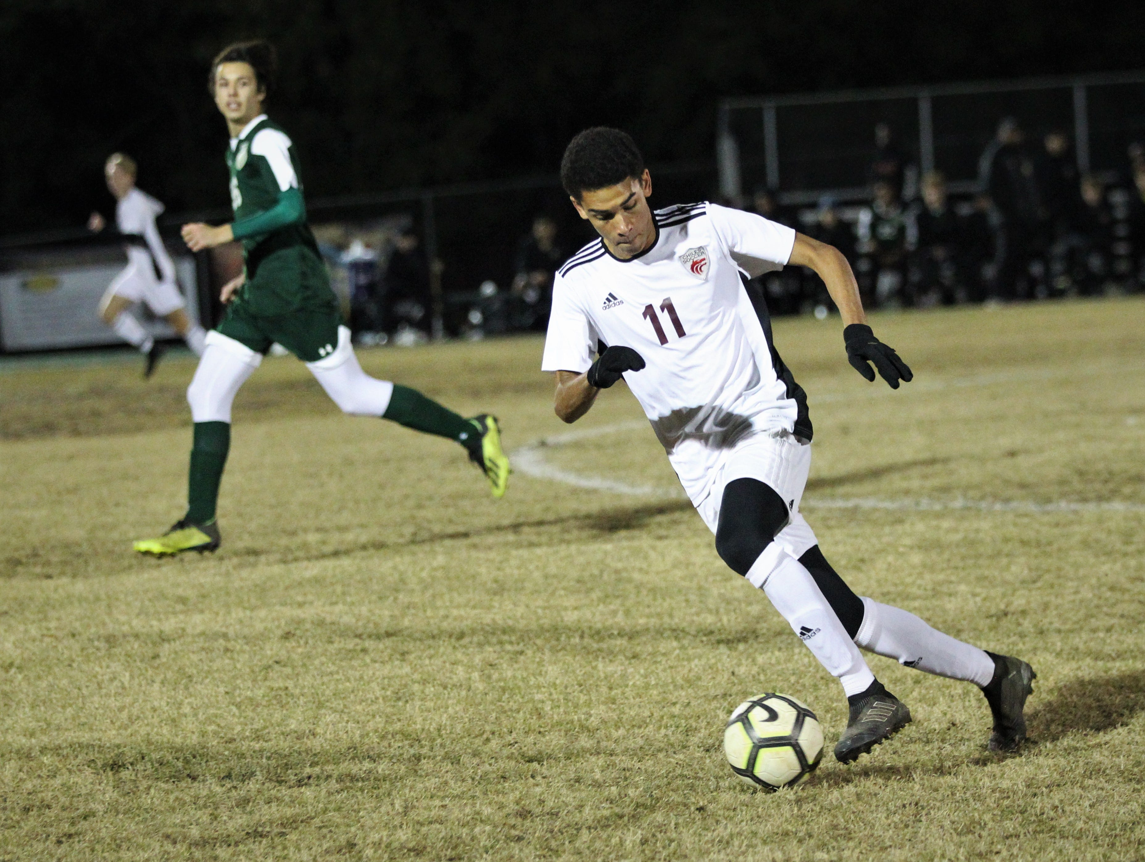 Chiles senior Will Johnson gains possession and races forward as Chiles' boys soccer team beat Lincoln 1-0 in a District 2-4A semifinal on Jan. 30, 2019.