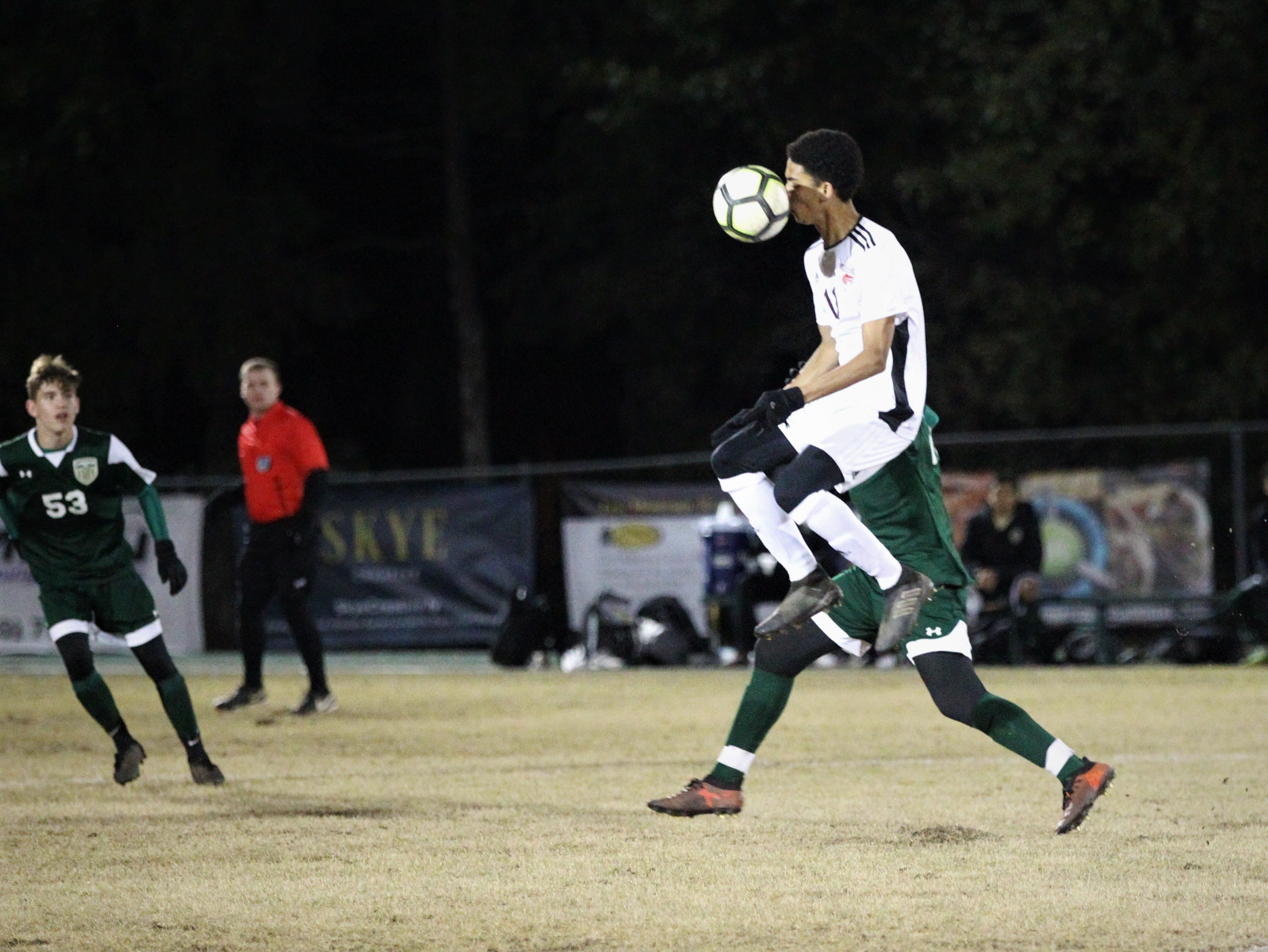 Chiles senior Will Johnson fights for a 50/50 ball as Chiles' boys soccer team beat Lincoln 1-0 in a District 2-4A semifinal on Jan. 30, 2019.