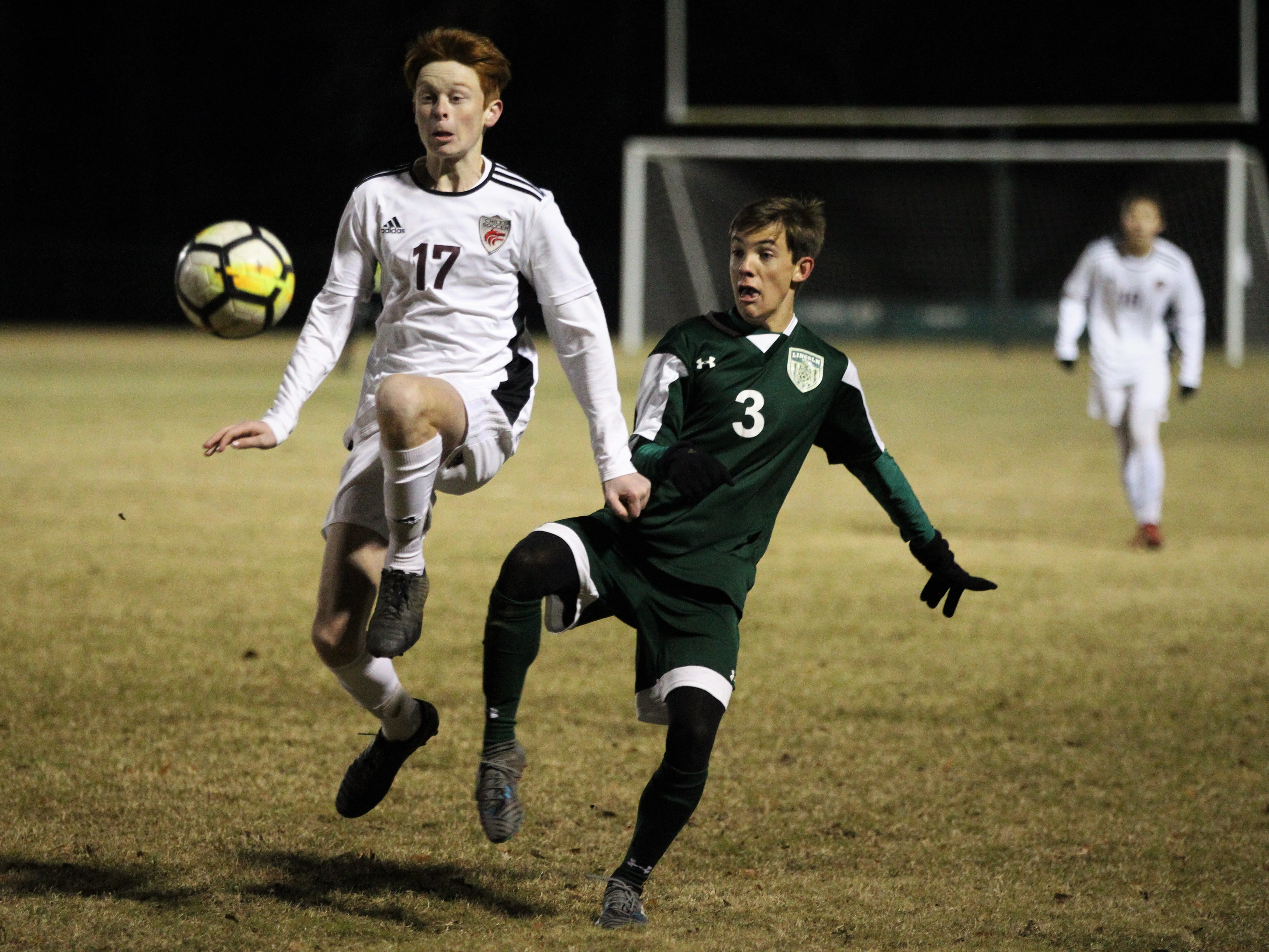 Chiles' Kyle Otis and Lincoln's Lukas Reiding battle for possession as Chiles' boys soccer team beat Lincoln 1-0 in a District 2-4A semifinal on Jan. 30, 2019.