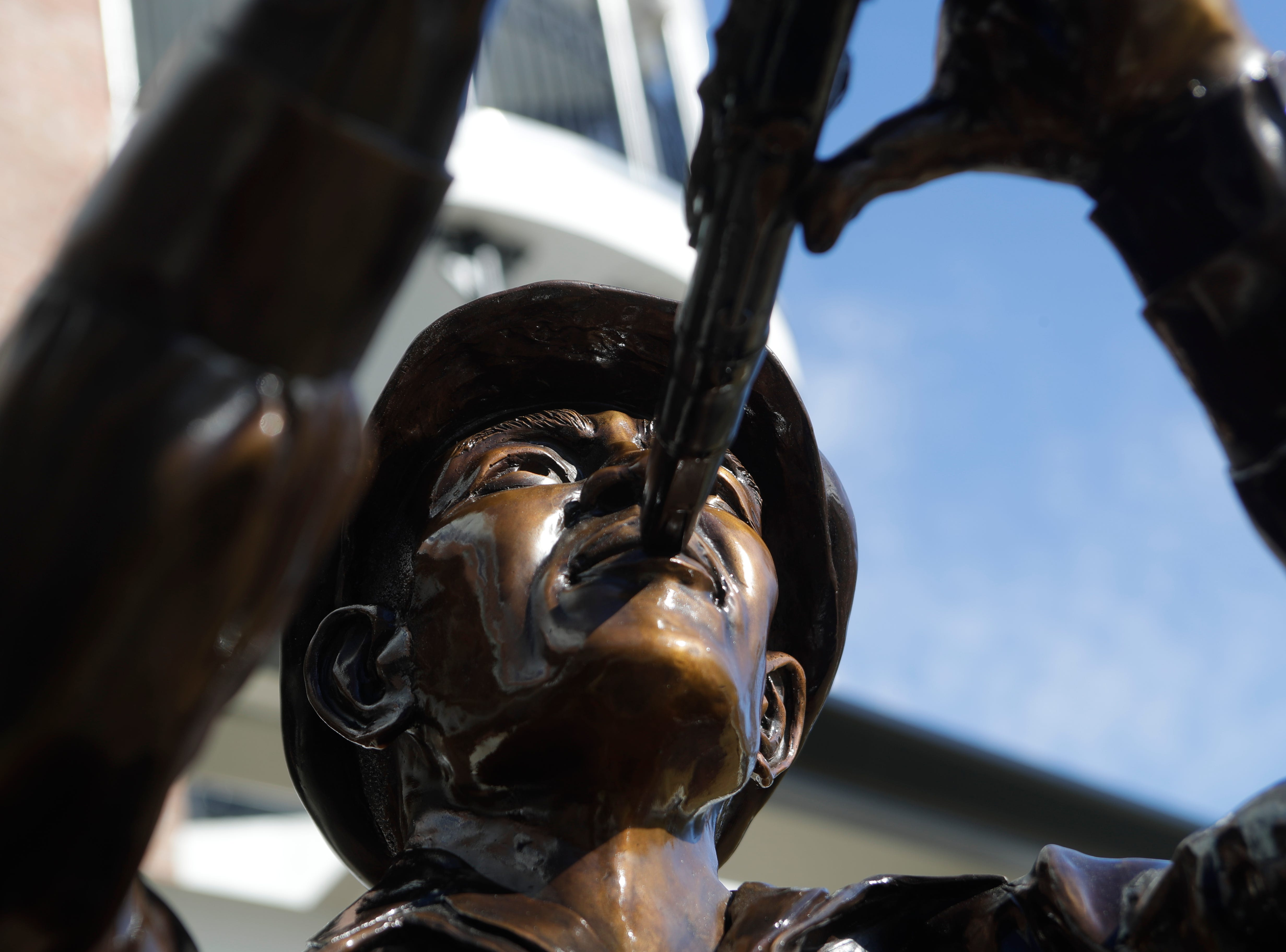 """A statue of Aurelío Angel Casañas stands in front of the Casañas Village Apartments at Frenchtown Square named after the Cuban immigrant who established his family in Tallahassee in the late 1800s. The statue portrays him playing the clarinet, which he played in a local group called """"The Tallahassee Band."""""""